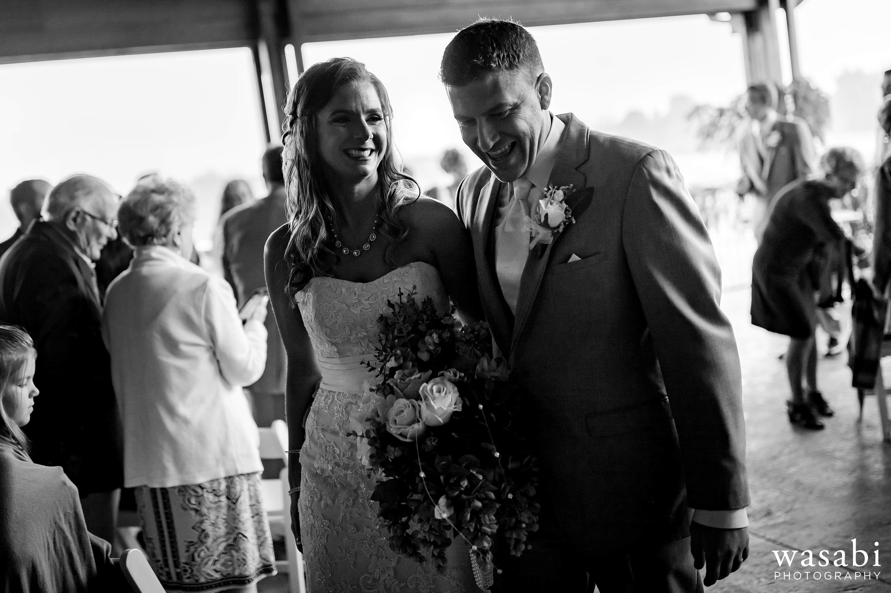 Bride and groom walk back down the aisle after Buck's Run Golf Club wedding ceremony in Mount Pleasant, Michigan.