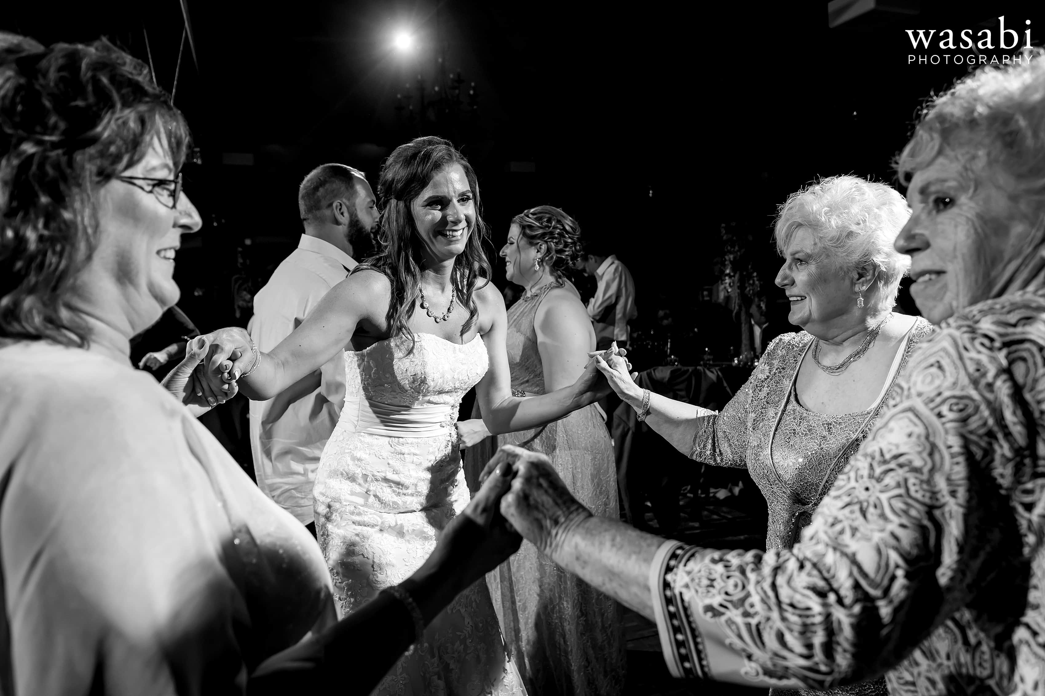 Bride and mother and grandmothers on the dance floor during Buck's Run Golf Club wedding reception in Mount Pleasant, Michigan.
