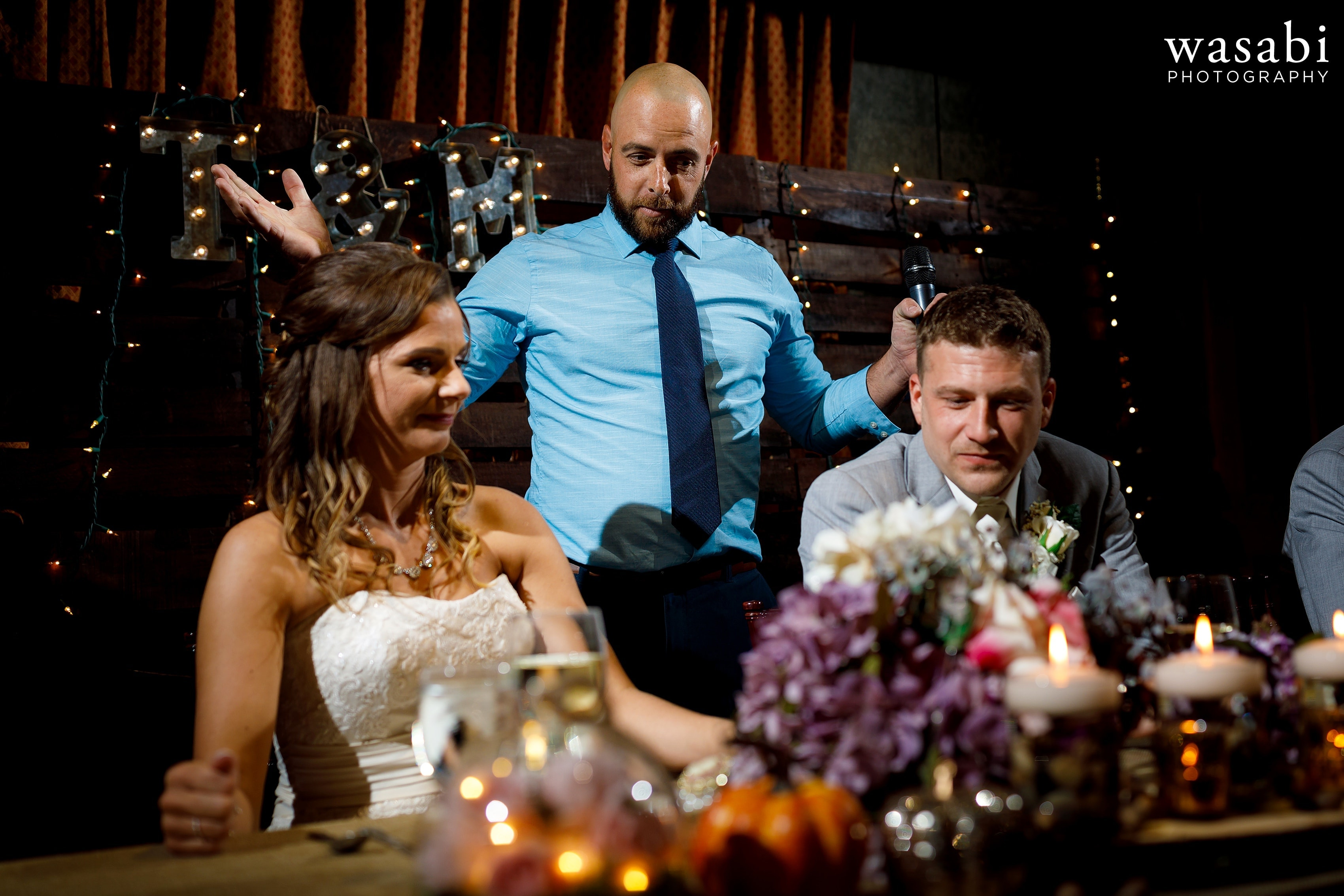 Friend of the groom gives toast during Buck's Run Golf Club wedding reception in Mount Pleasant, Michigan.