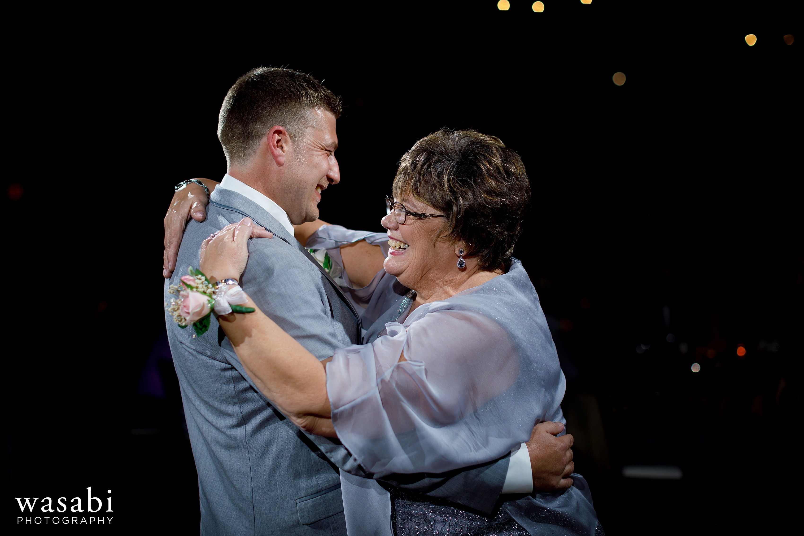 Groom and mother share first dance during Buck's Run Golf Club wedding reception in Mount Pleasant, Michigan.