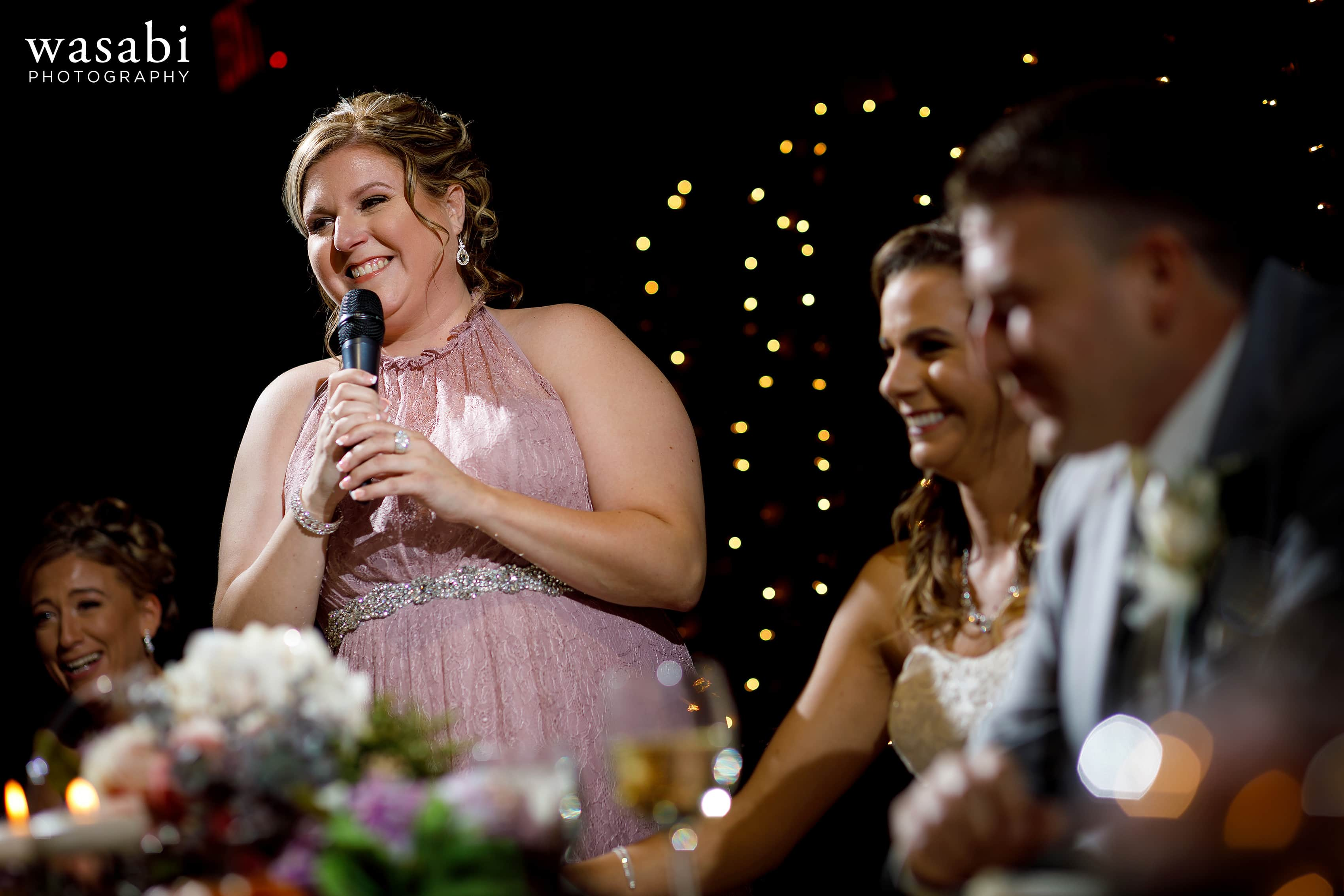 Maid of honor gives toast during Buck's Run Golf Club wedding reception in Mount Pleasant, Michigan.