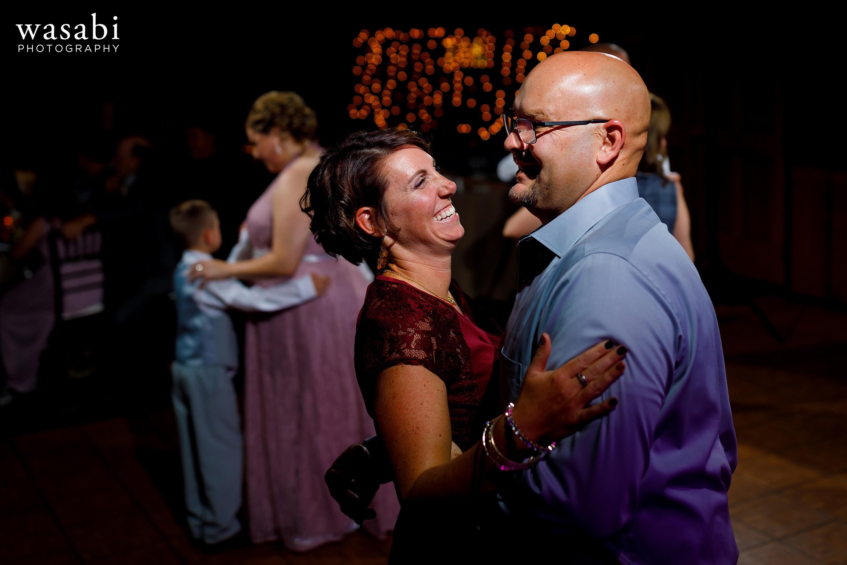 Wedding guests on the dance floor during Buck's Run Golf Club wedding reception in Mount Pleasant, Michigan.