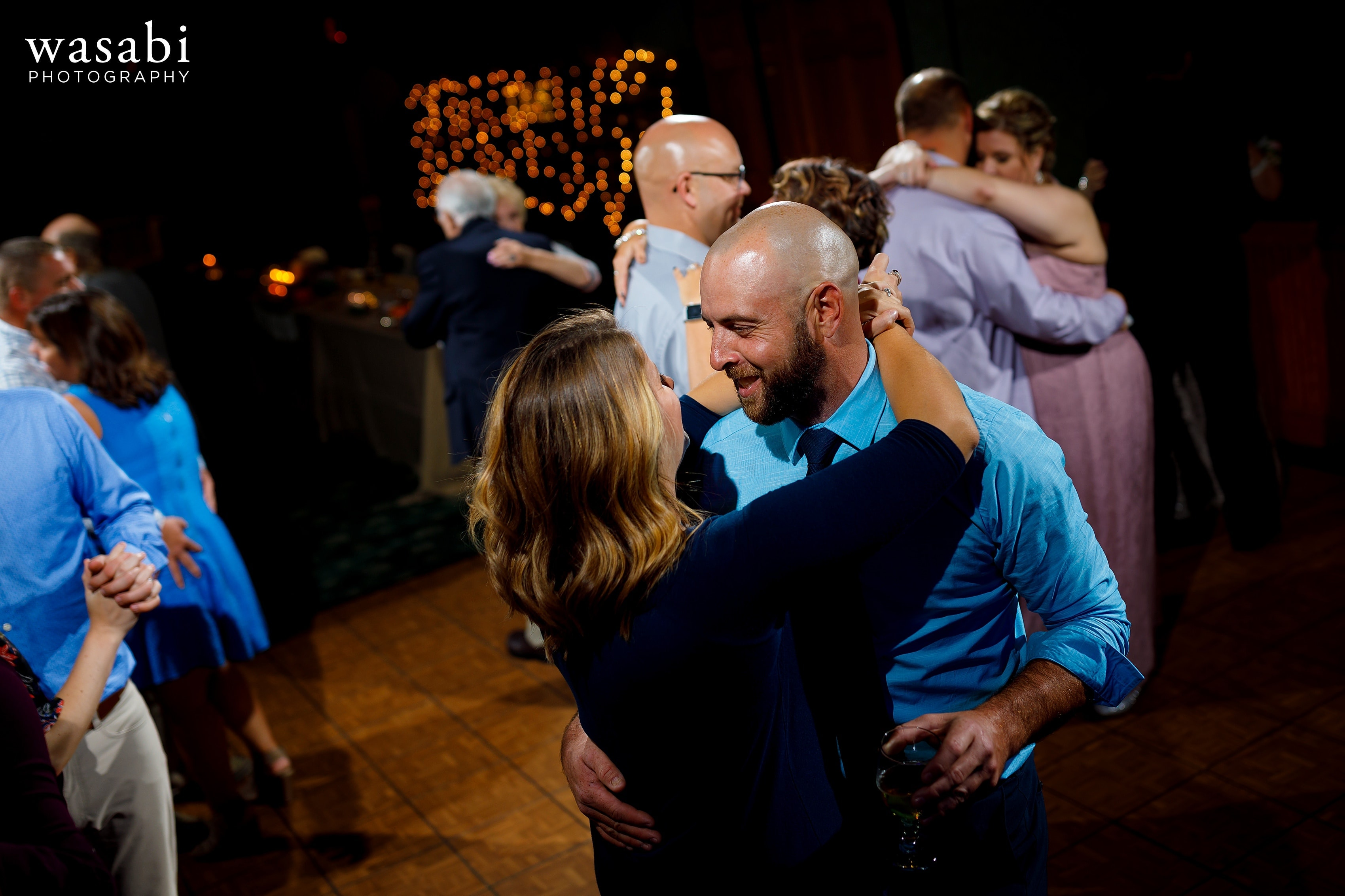 Wedding guests on the dance floor during Buck's Run Golf Club wedding reception in Mount Pleasant, Michigan.