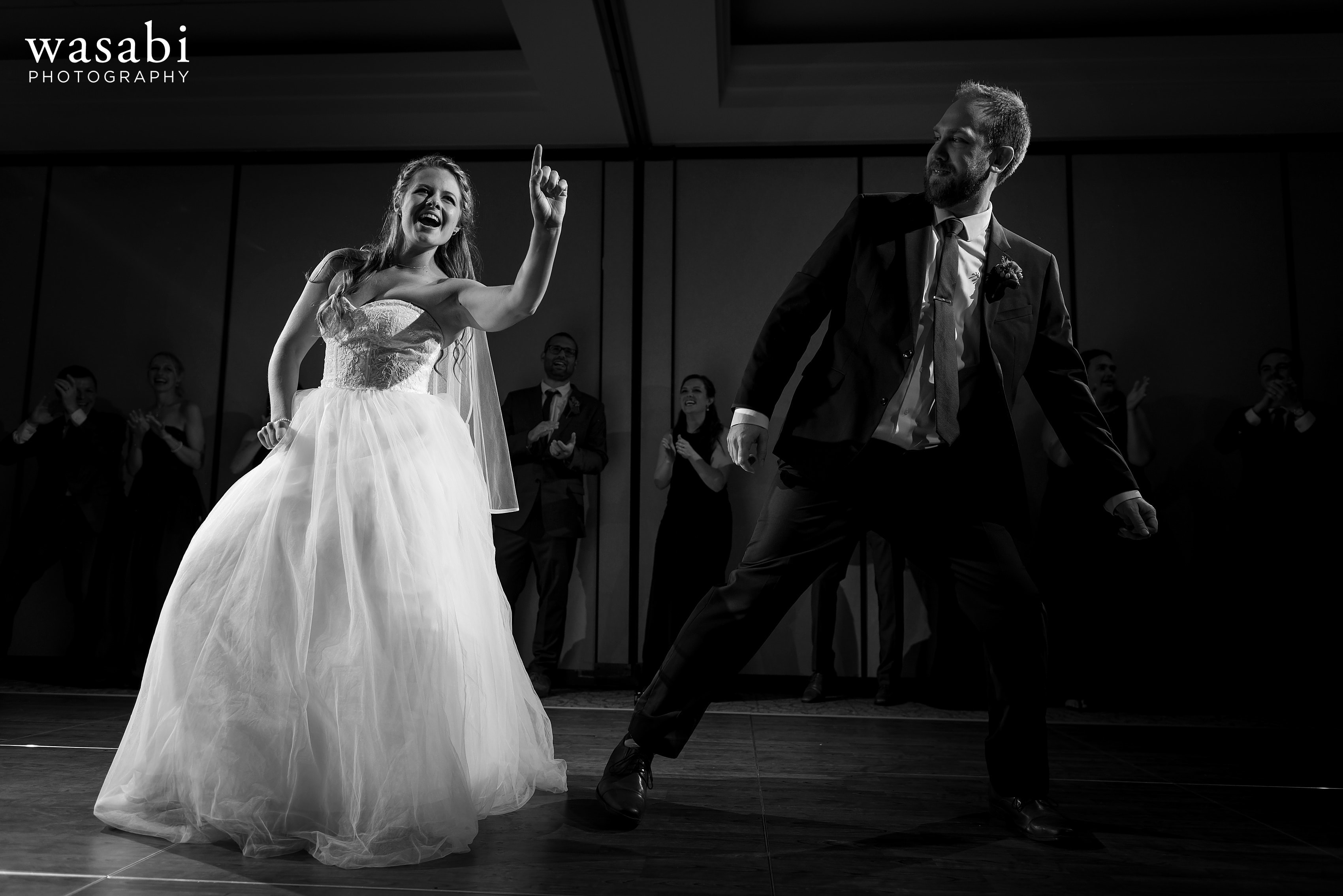 Bride and groom dance during their introductions of their wedding reception at Eberhard Center
