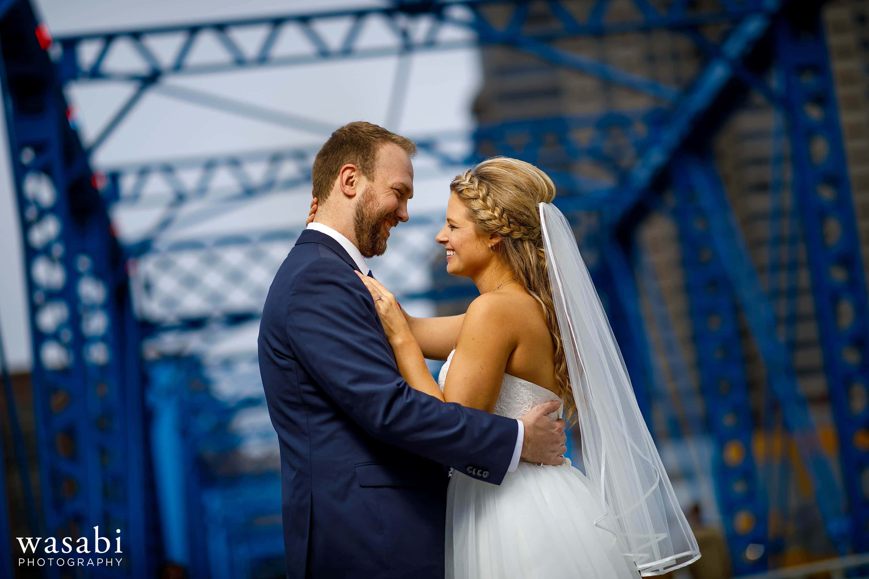 Bride and groom portrait during blue bridge wedding photos