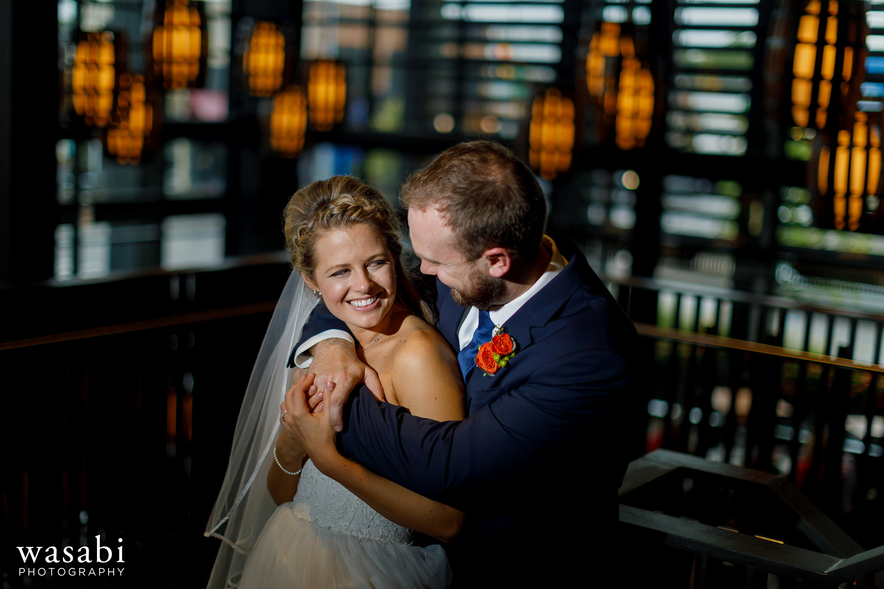 Bride and groom pose for a portrait at The Knickerbocker in downtown Grand Rapids