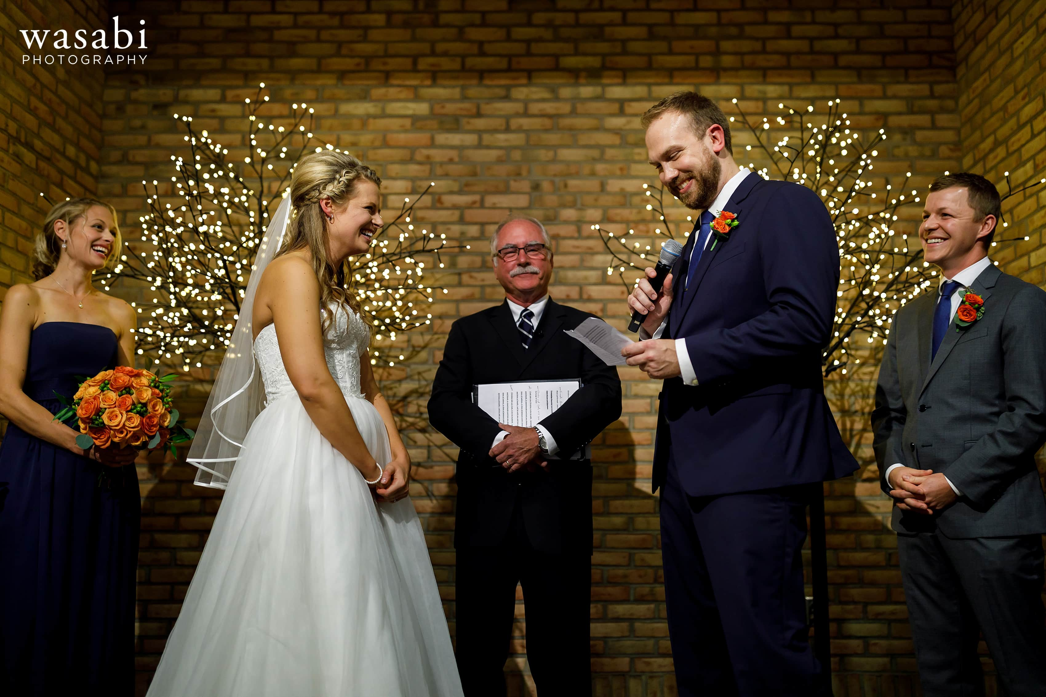 bride and groom exchange vows during their wedding at Eberhard Center in downtown Grand Rapids