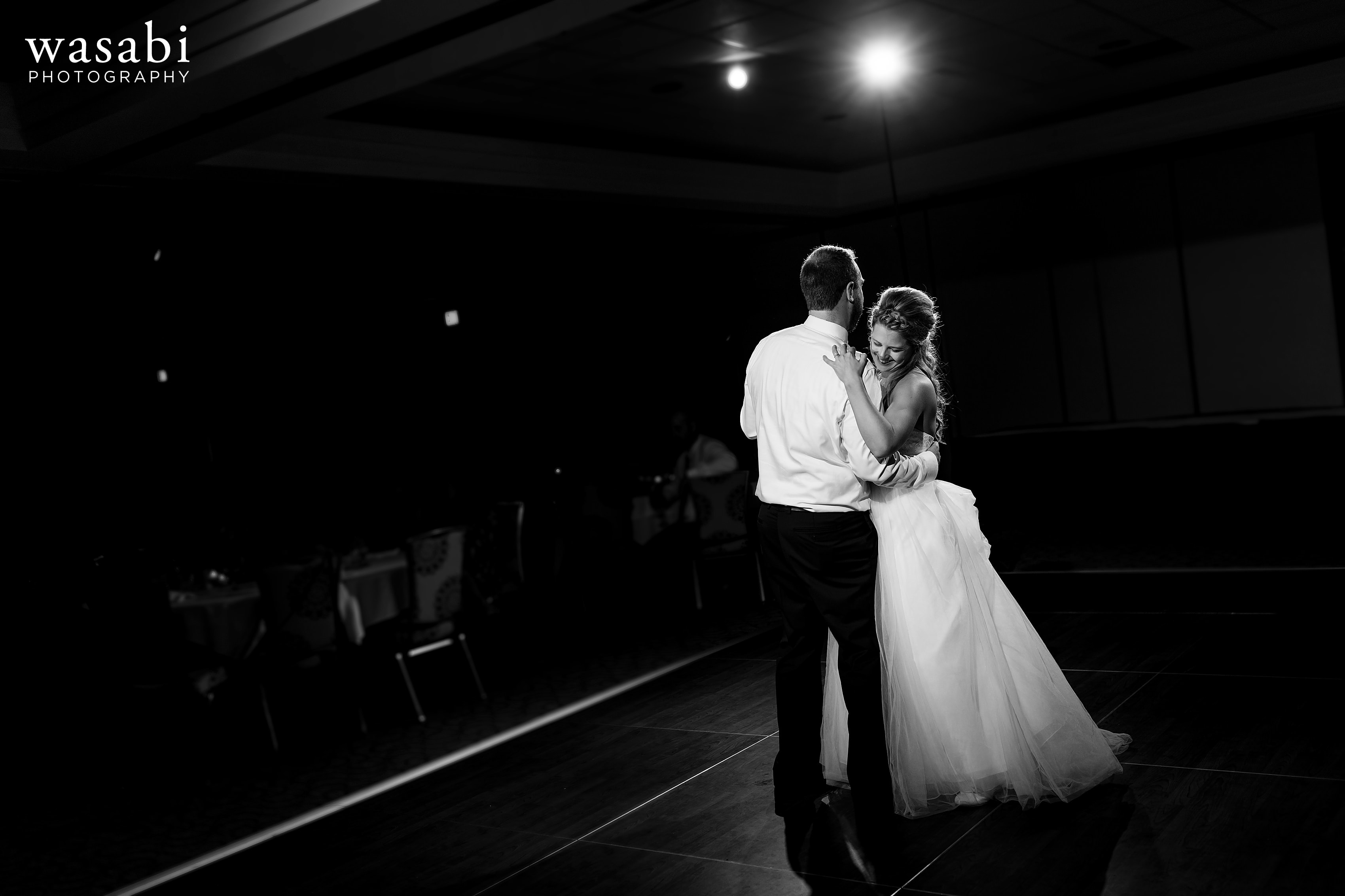 bride and groom share a first dance during a wedding reception at Eberhard Center in downtown Grand Rapids