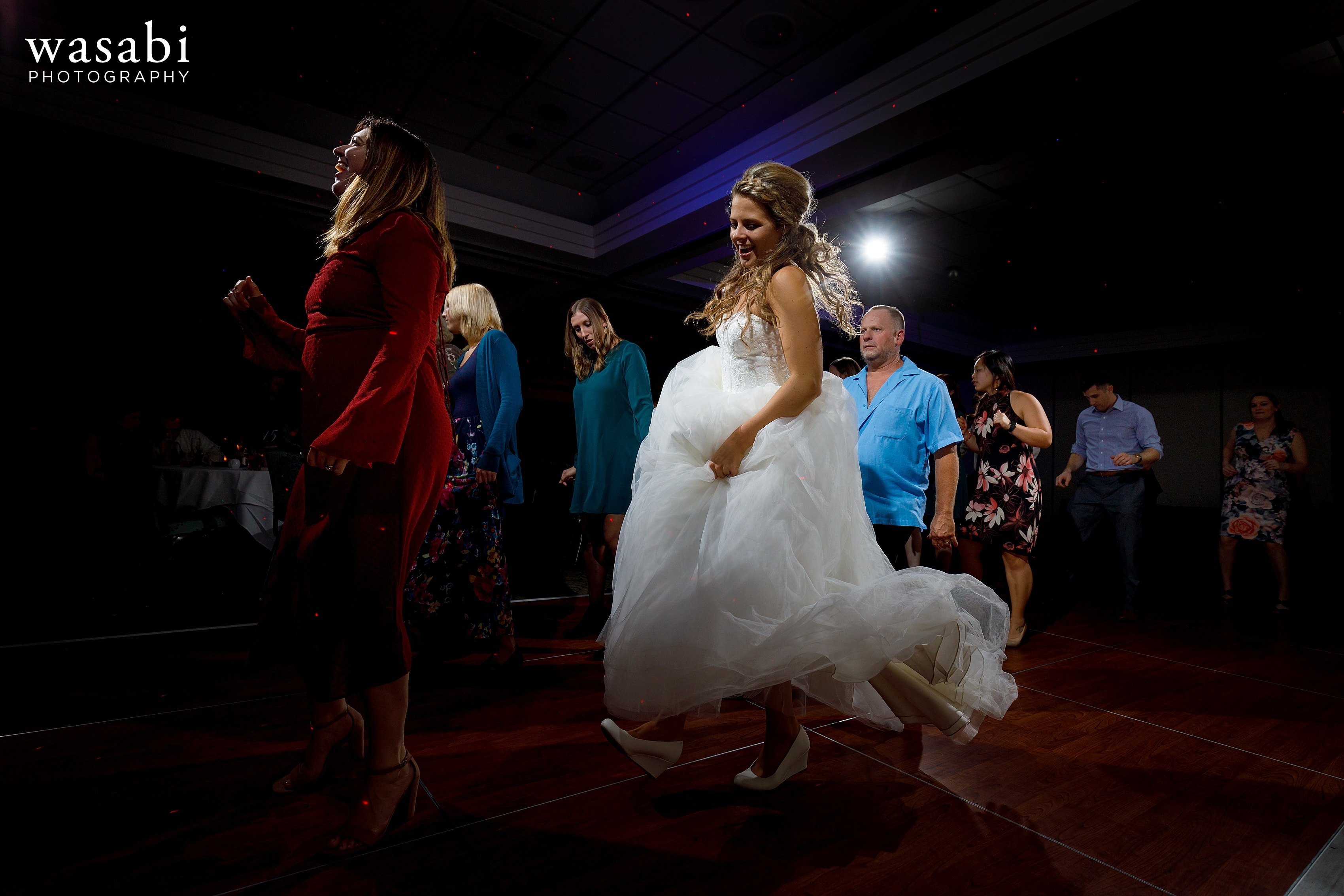 bride and guests dance during a Eberhard Center wedding reception