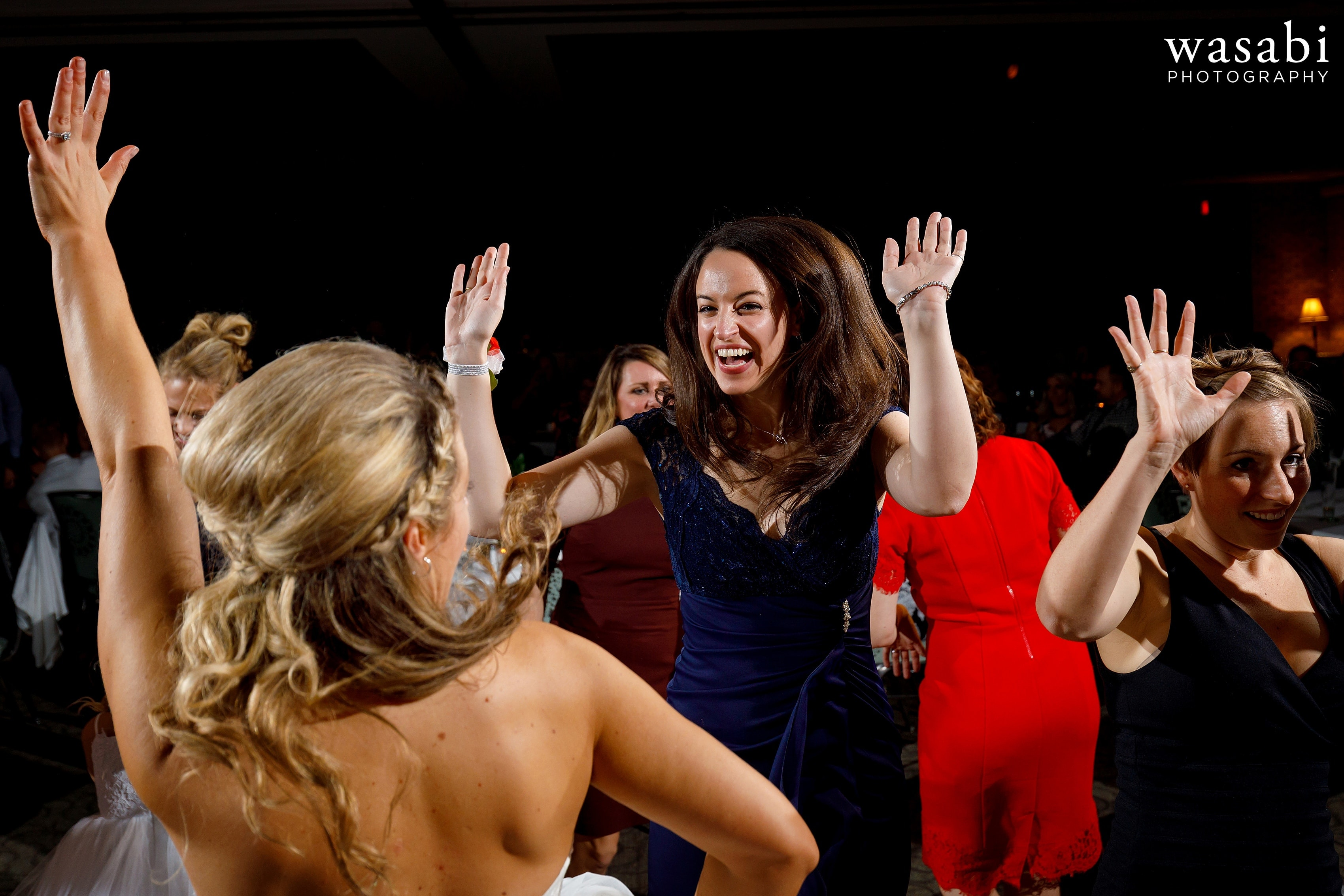 bride dances with guests during their Eberhard Center wedding reception