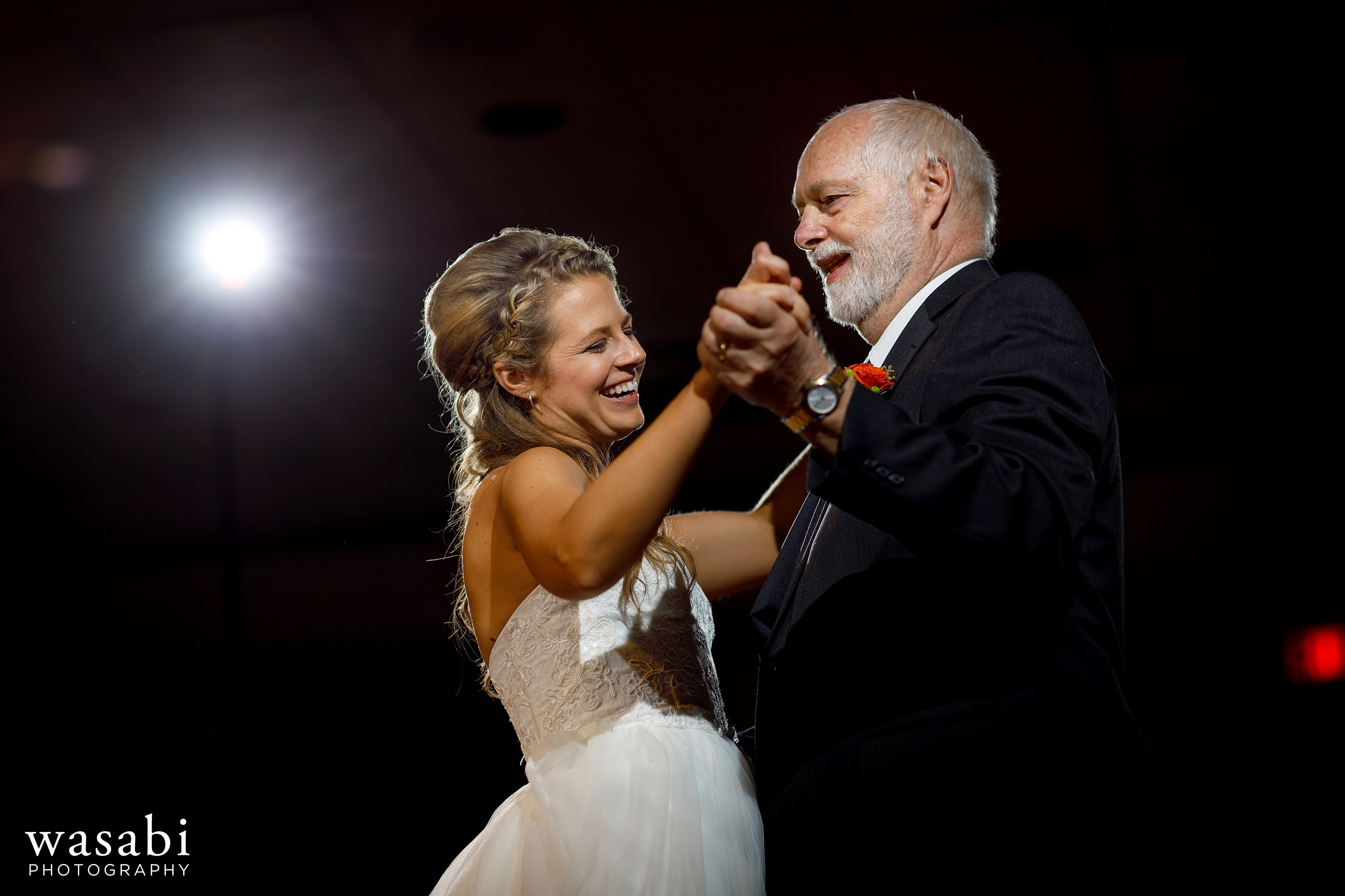 bride shares a first dance with her father during a wedding reception at Eberhard Center in downtown Grand Rapids