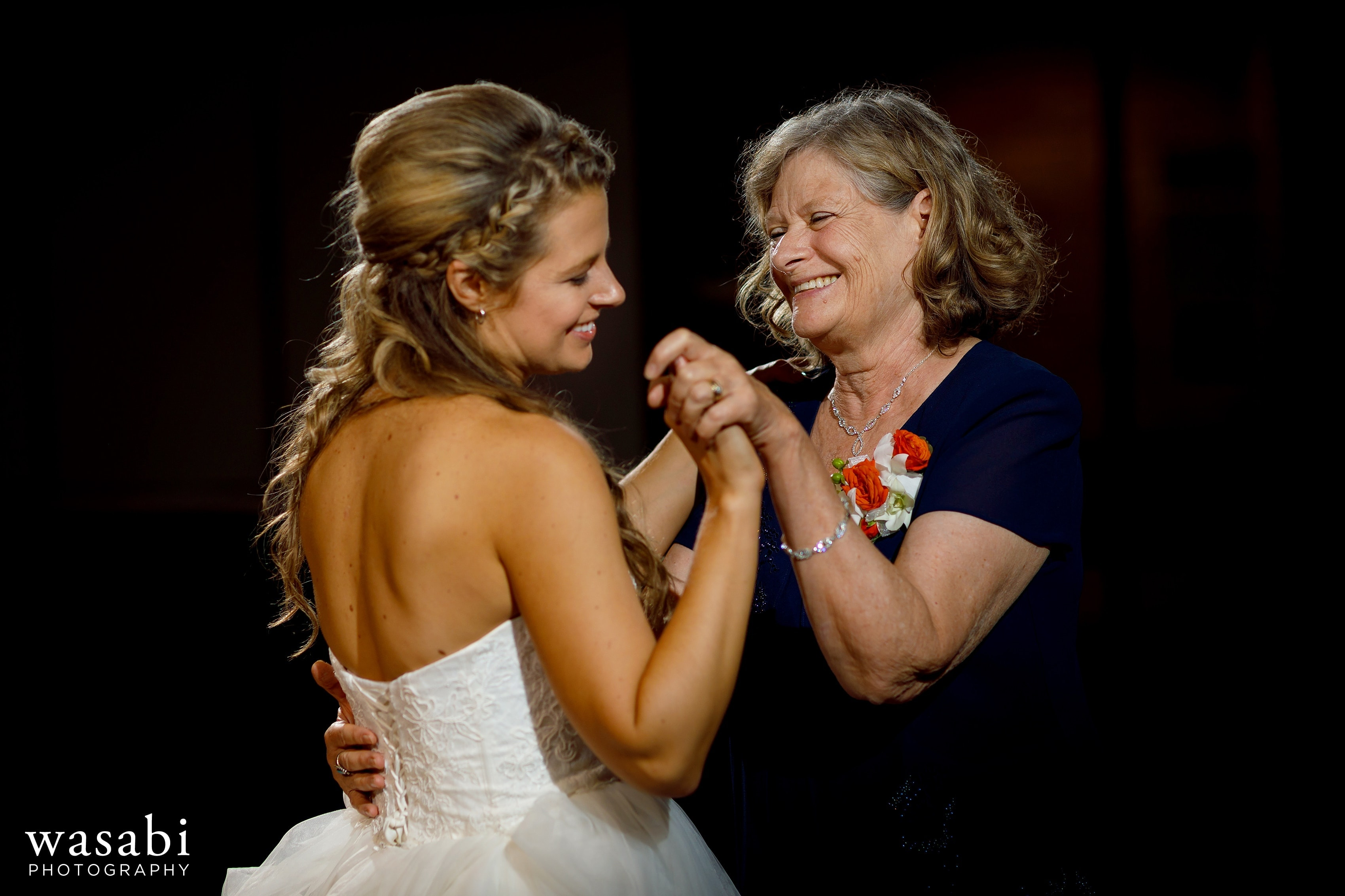 bride shares a first dance with her mother during a wedding reception at Eberhard Center in downtown Grand Rapids