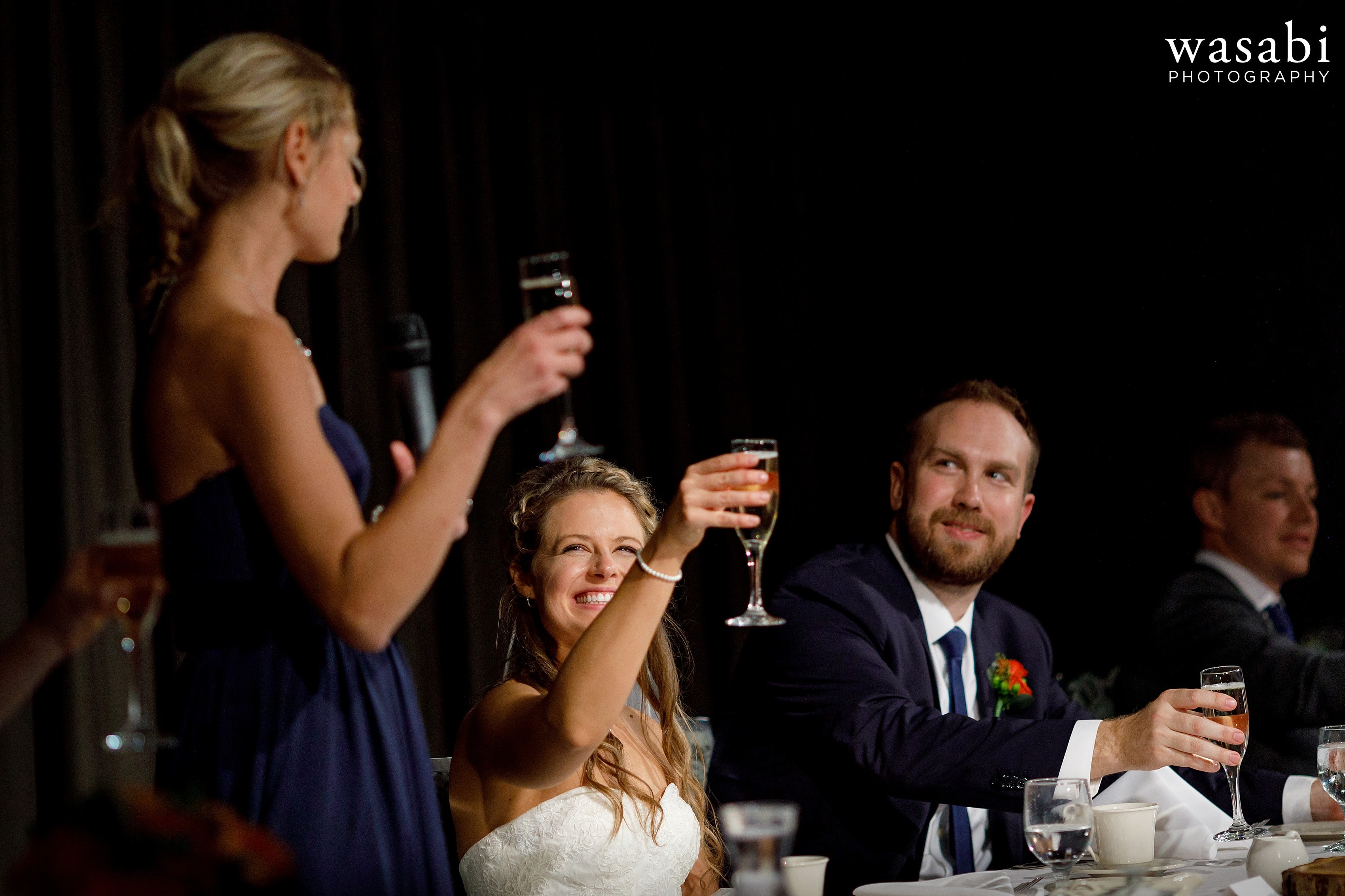 bridesmaid gives a toast during a wedding reception at Eberhard Center in downtown Grand Rapids