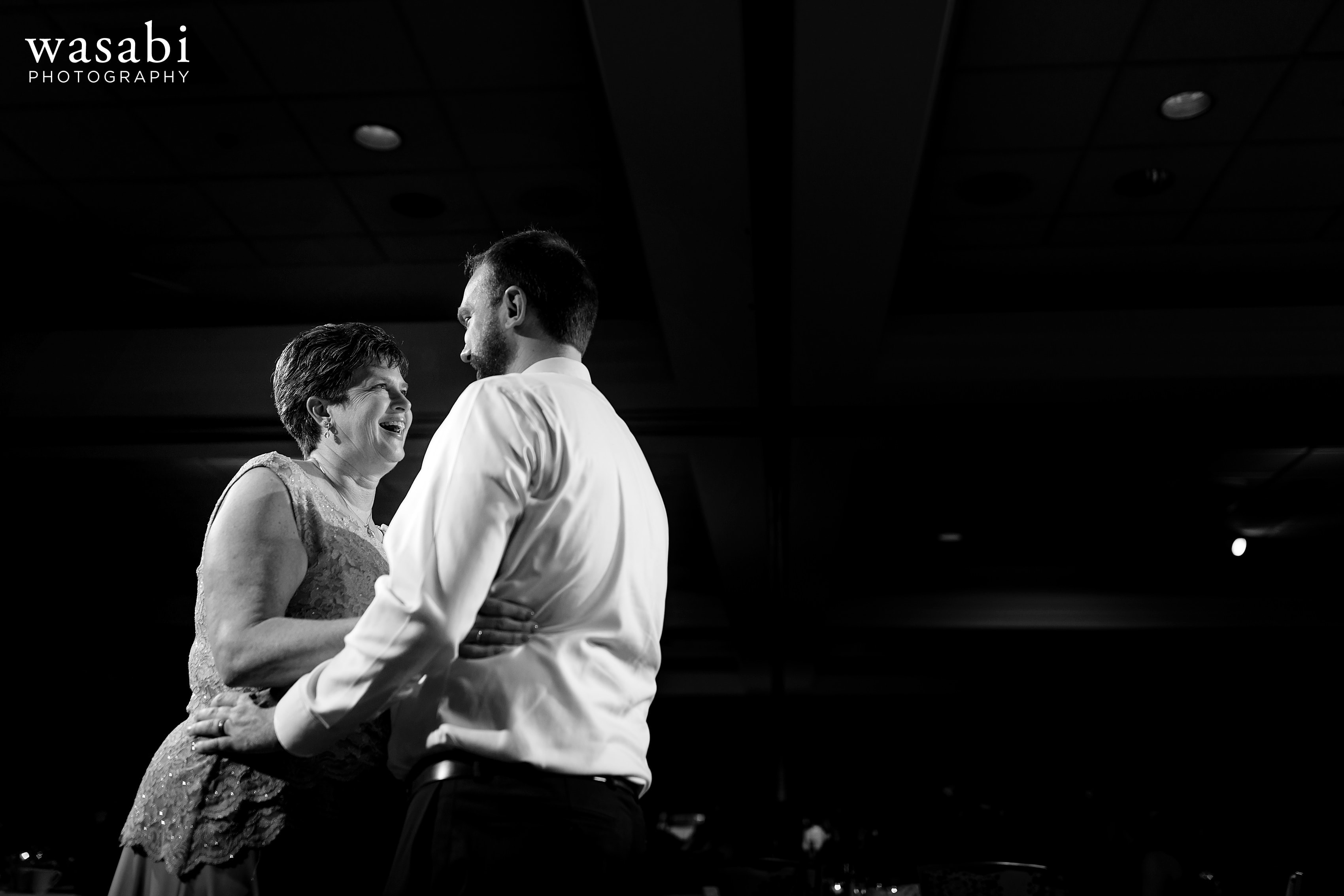 groom shares a first dance with his mother during a wedding reception at Eberhard Center in downtown Grand Rapids