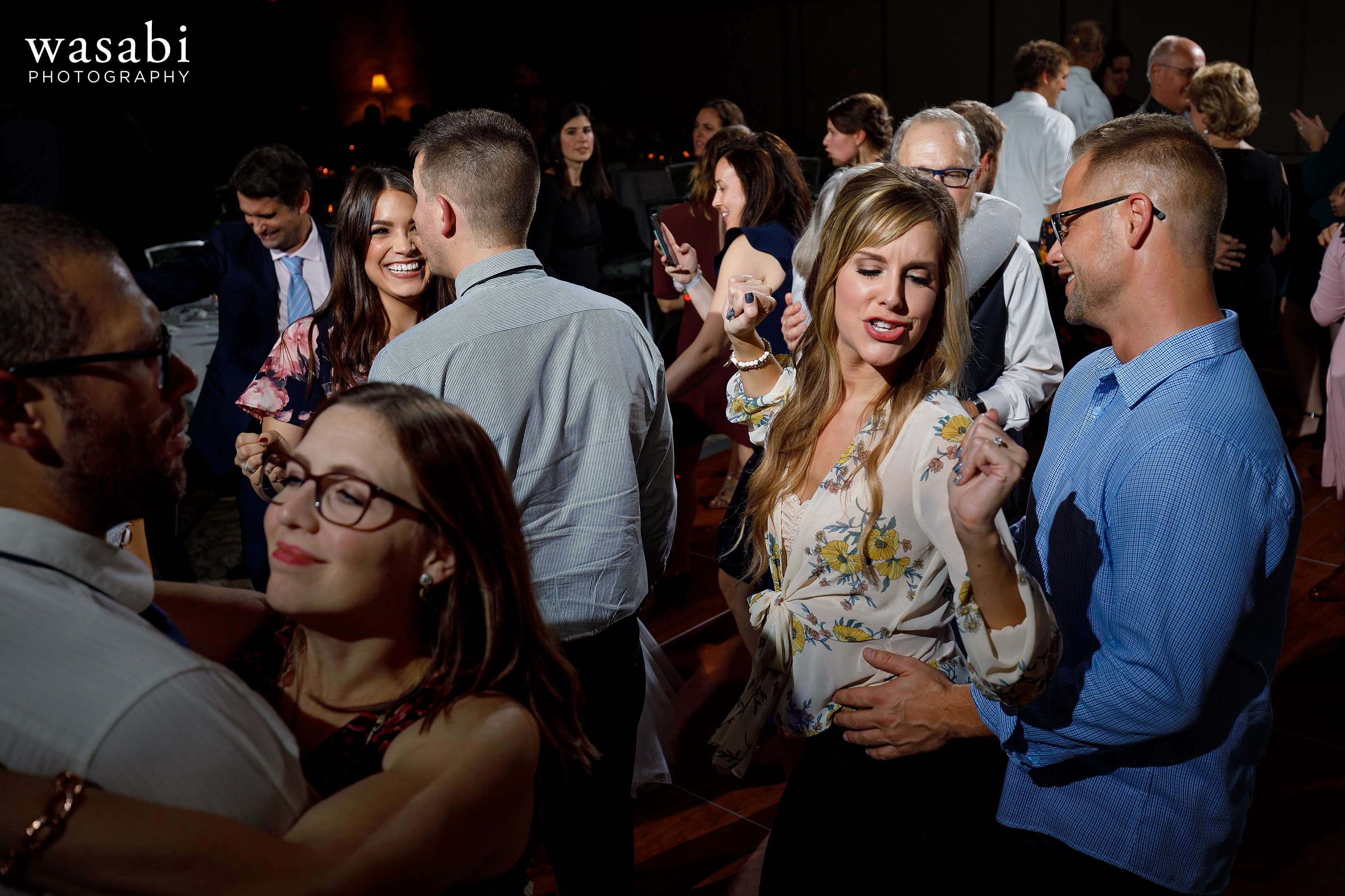guests dance during a Eberhard Center wedding reception