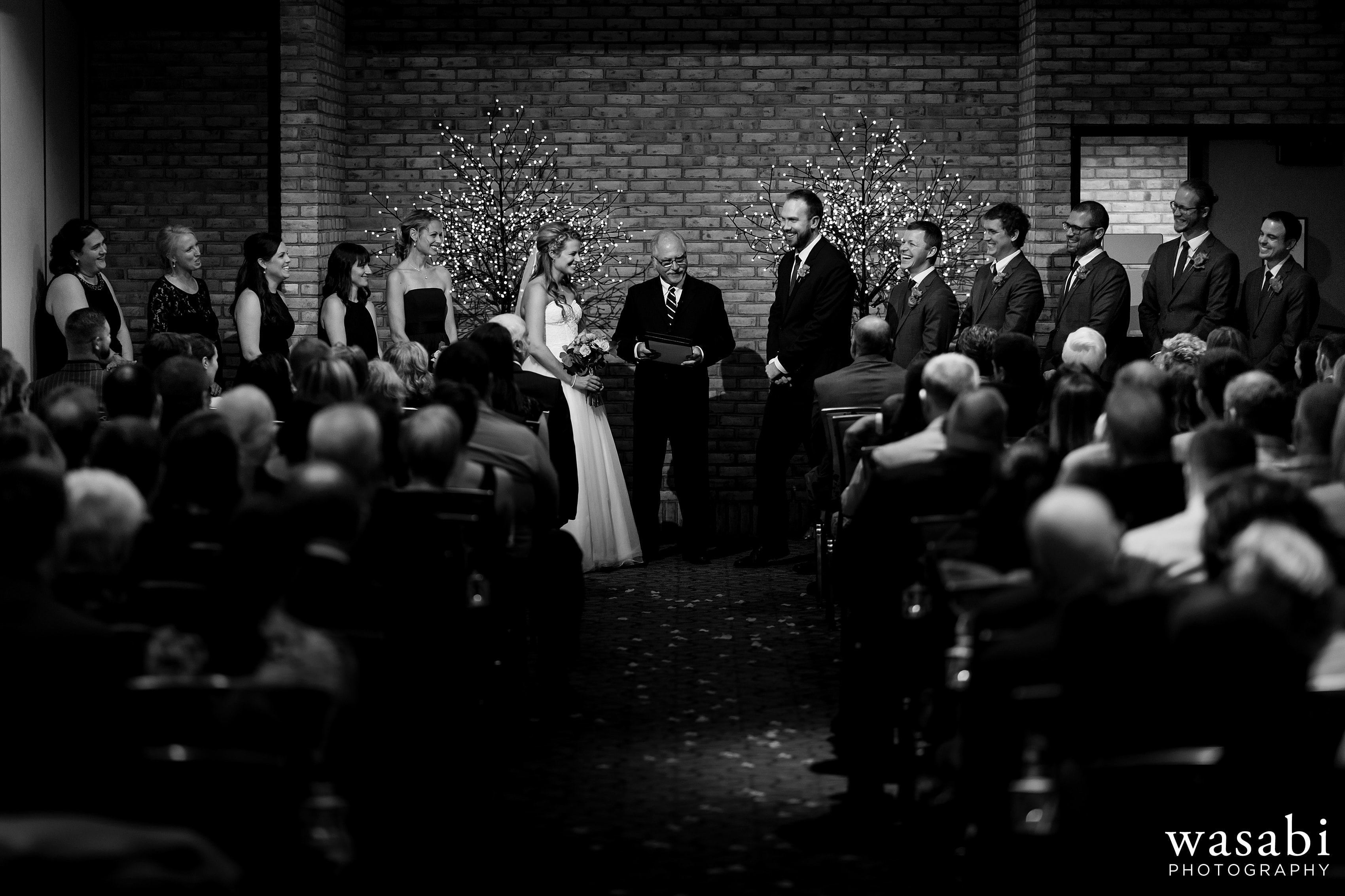 wide angle view of wedding ceremony at Eberhard Center in downtown Grand Rapids