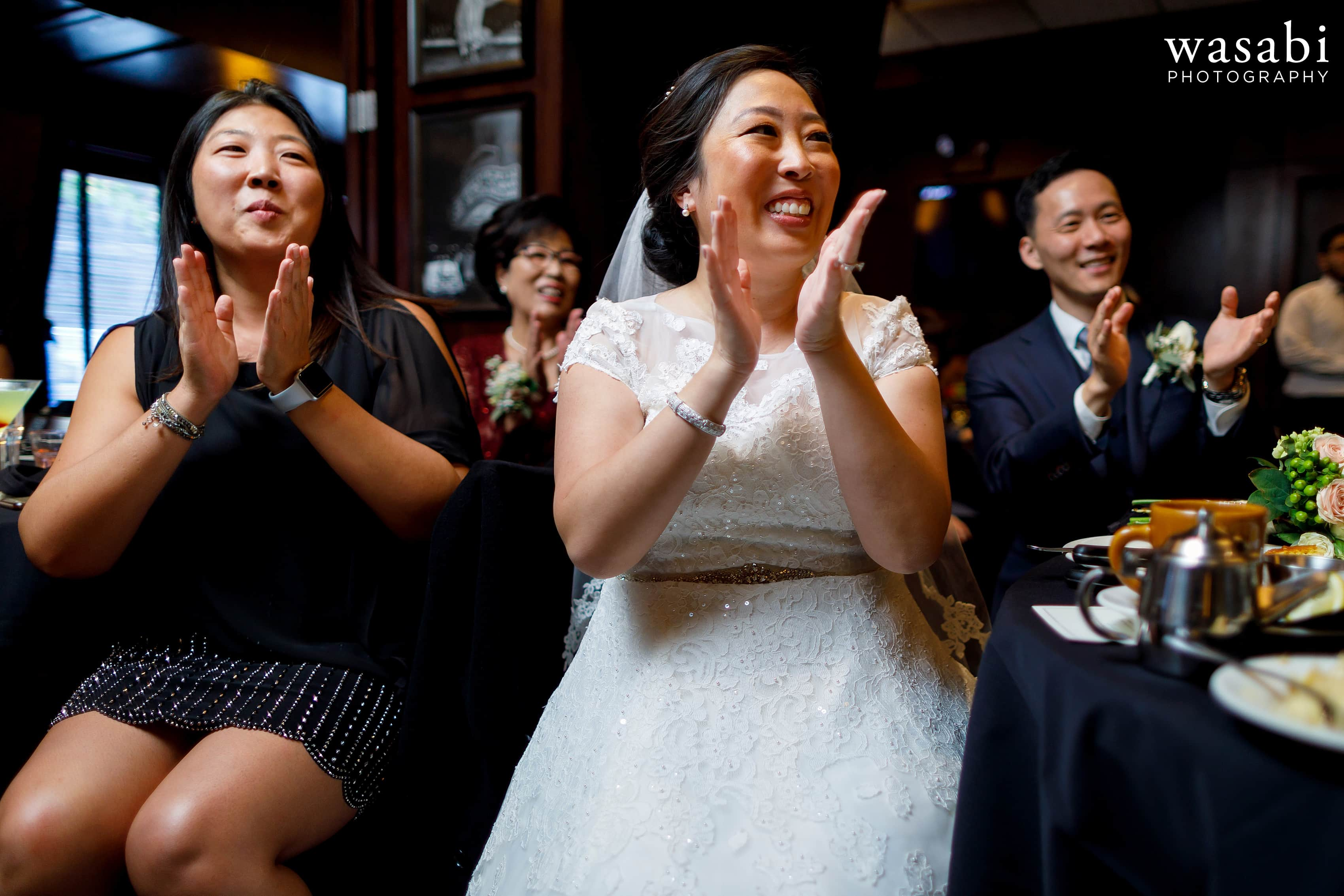 bride and groom and guests cheer during games at a Wildfire Restaurant wedding reception in Chicago