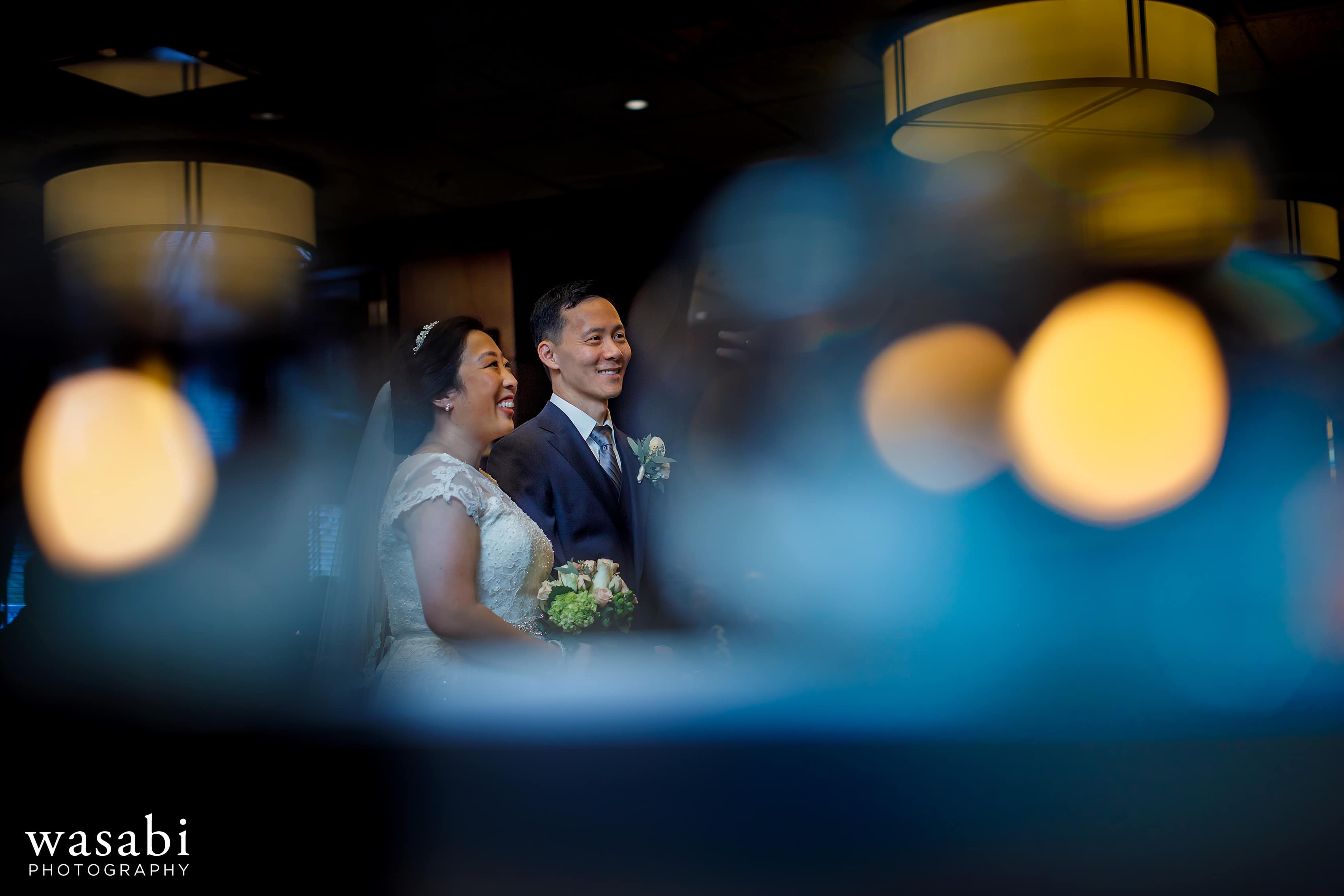 bride and groom laugh during Wildfire Restaurant wedding ceremony in Chicago