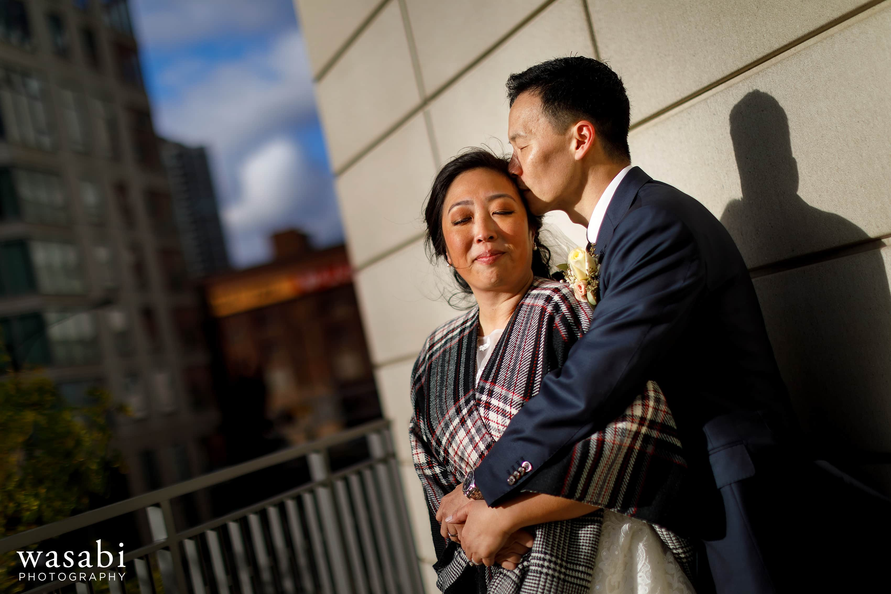 bride and groom pose for a portrait outside Gibson's Italia on the Chicago River after their wedding ceremony