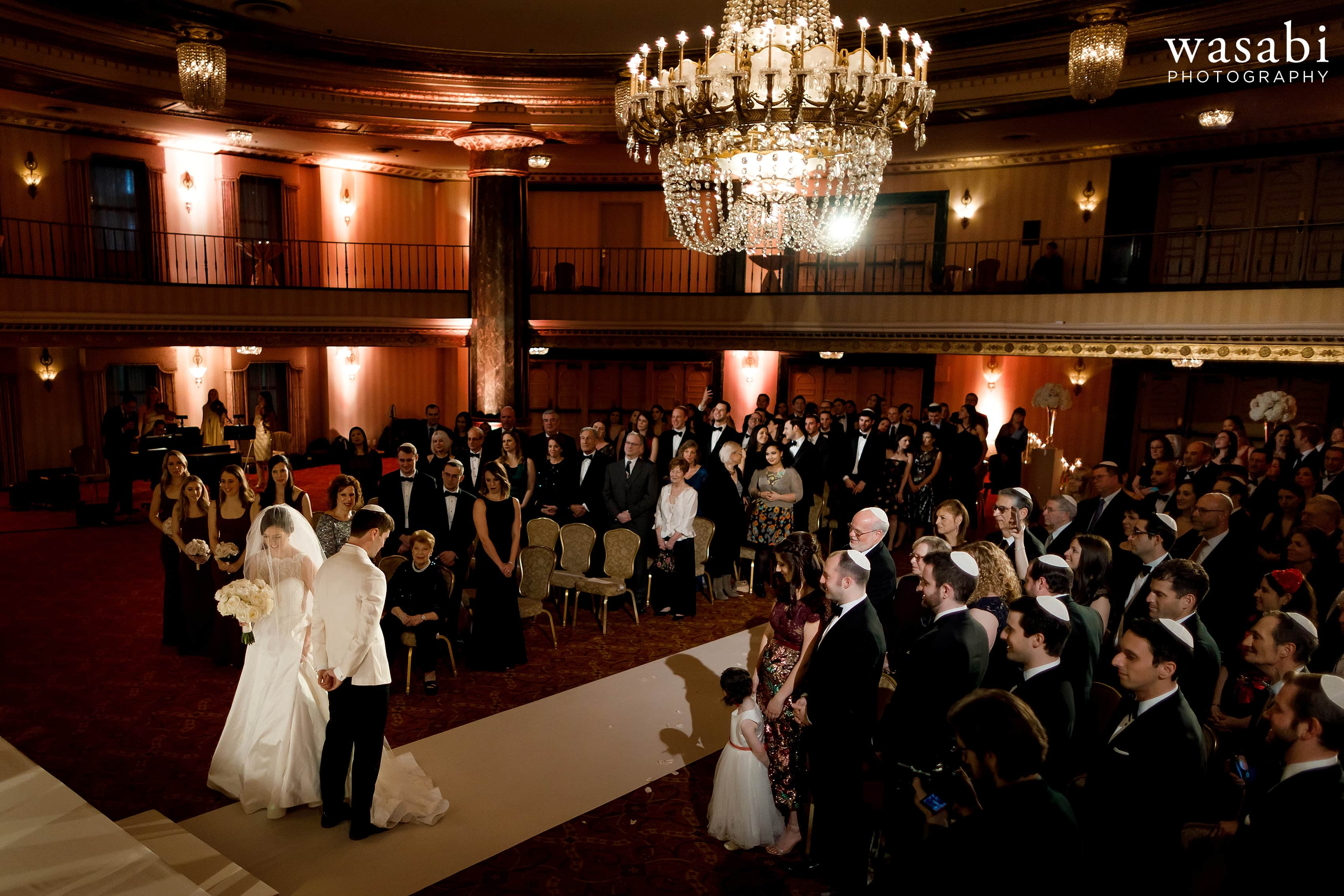 Bride circles Groom as part of hakafot circling ceremony during Jewish wedding ceremony at InterContinental Chicago Magnificent Mile Hotel
