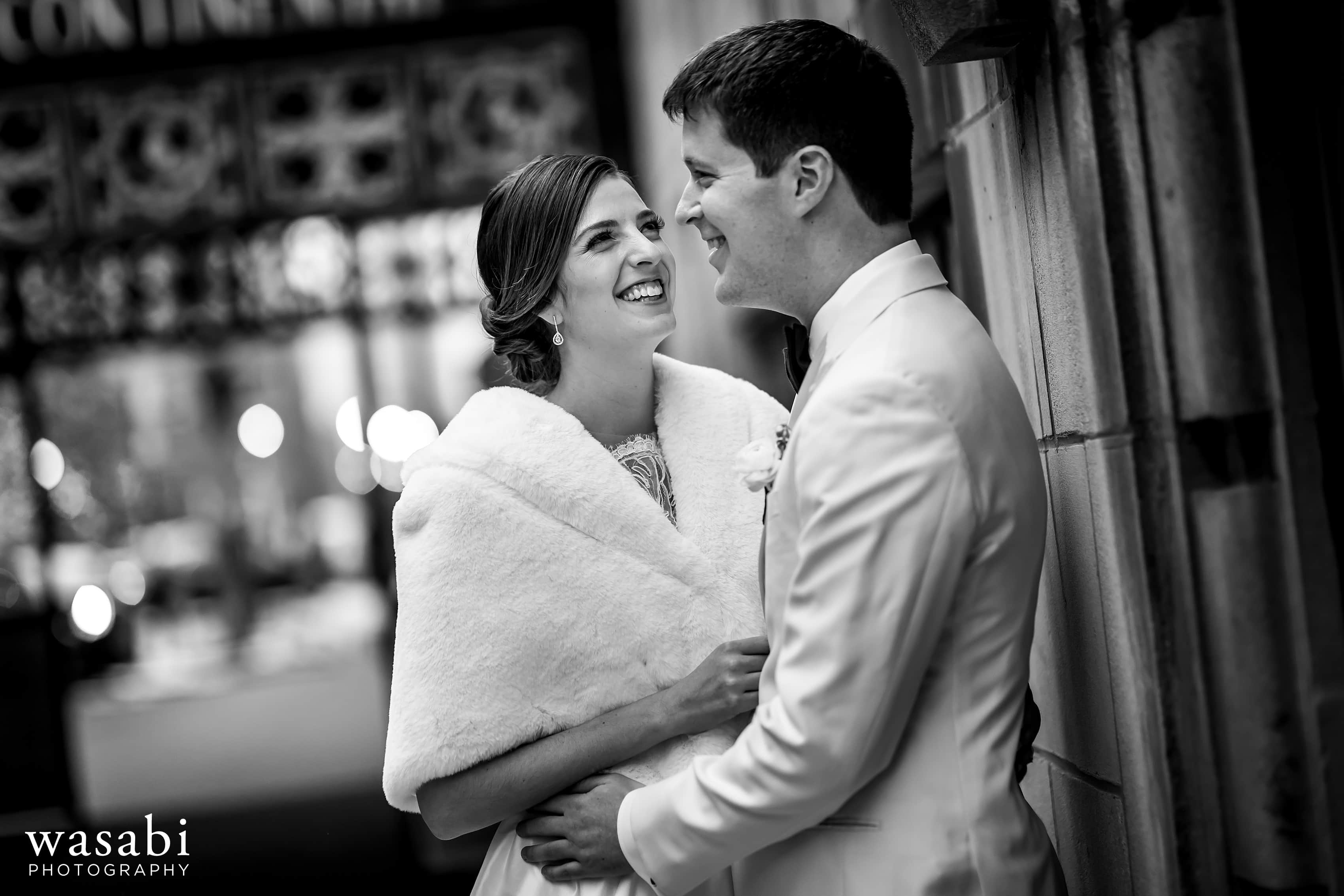 bride and groom pose for a portrait outside of InterContinental Chicago Magnificent Mile Hotel