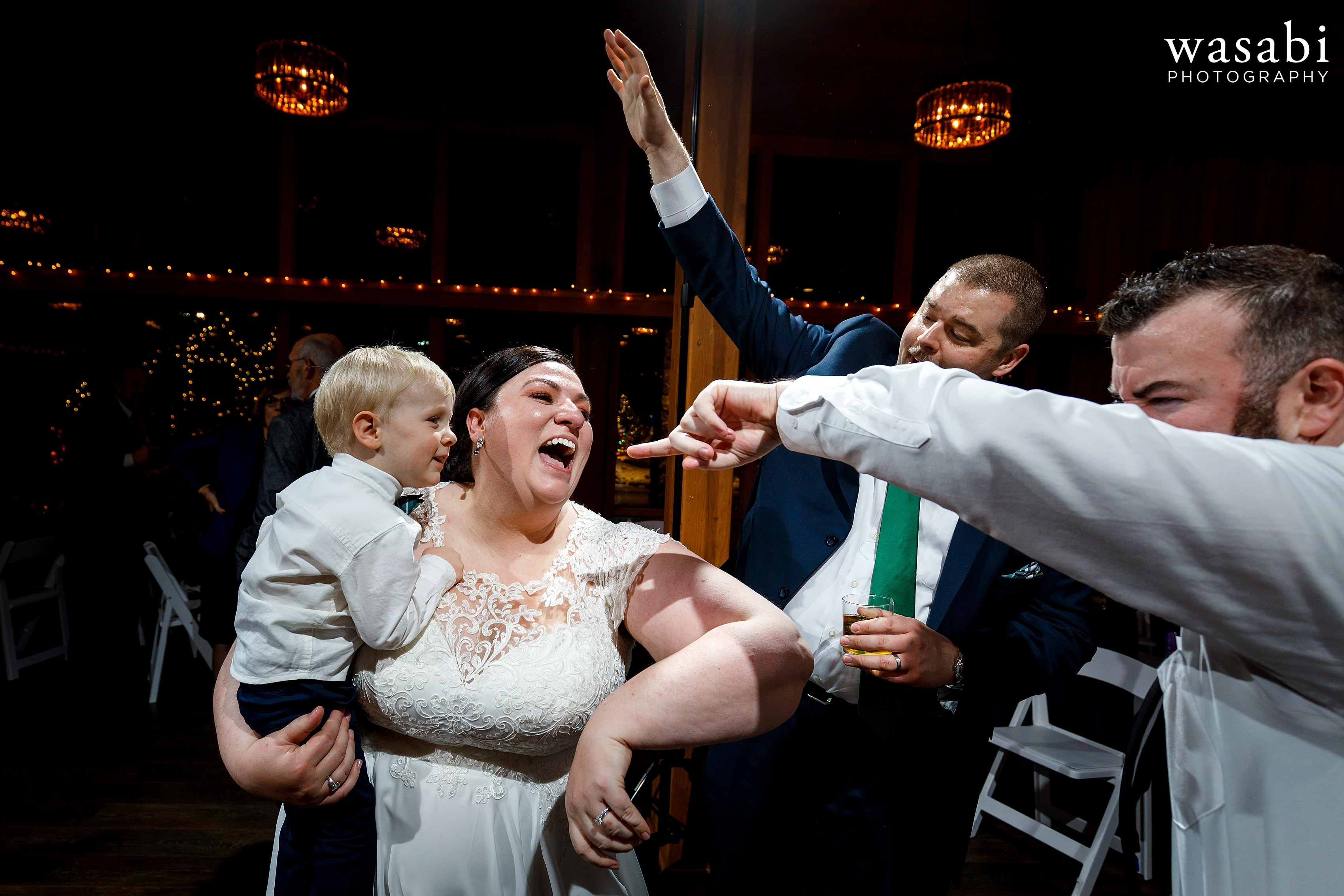 bride and groom dance with ring bearer during wedding reception at Oak Brook Bath and Tennis Club