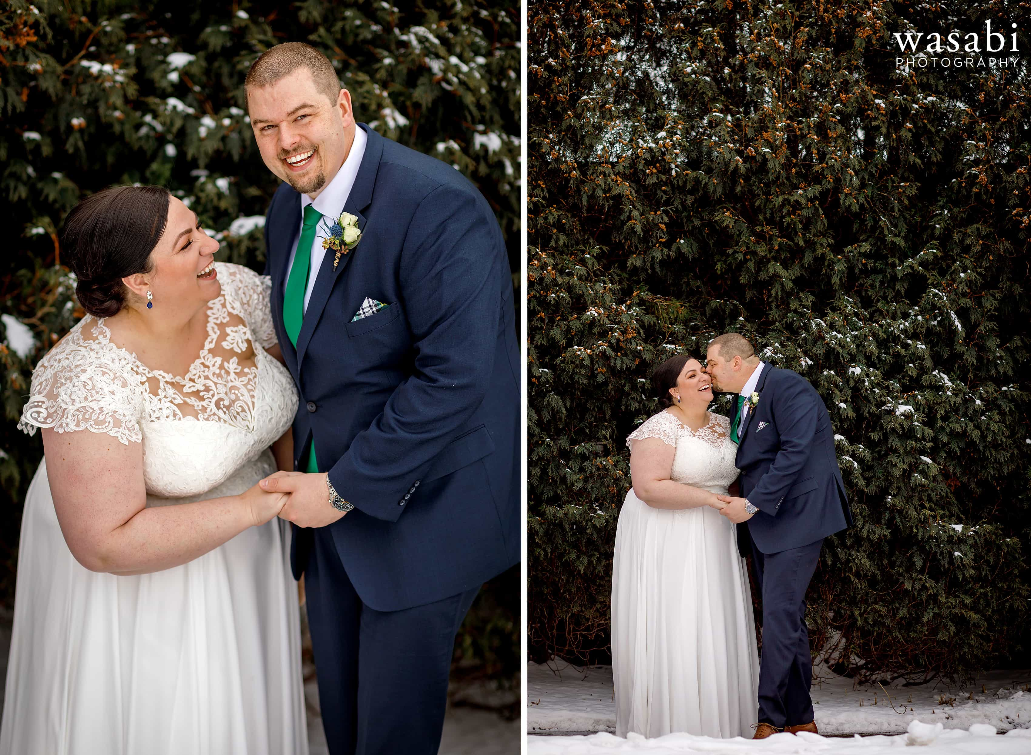 bride and groom pose for wedding portraits in front of green coniferous bush with snow covered branches