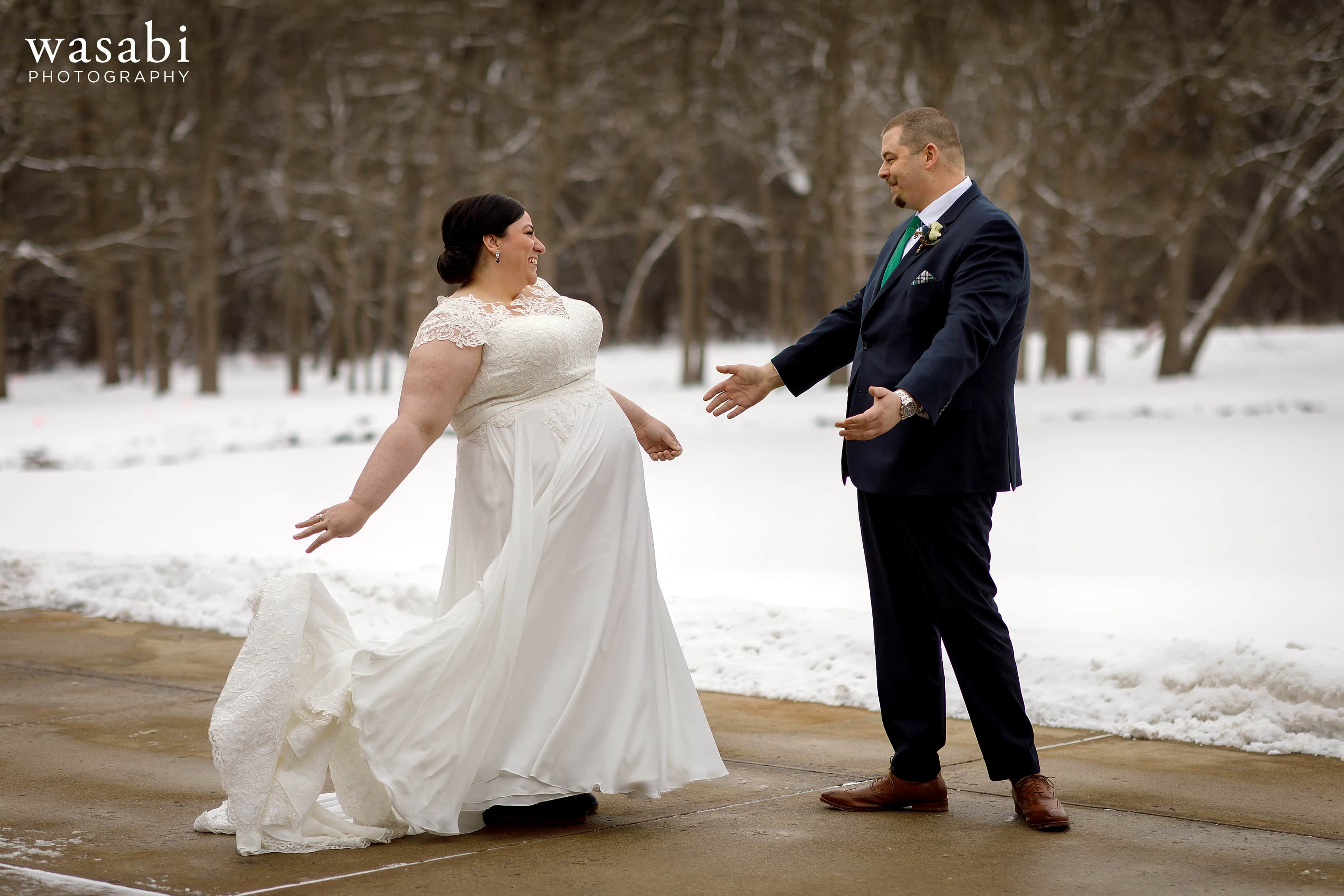bride and groom react to seeing each other for the first time during a first look with snow in the background
