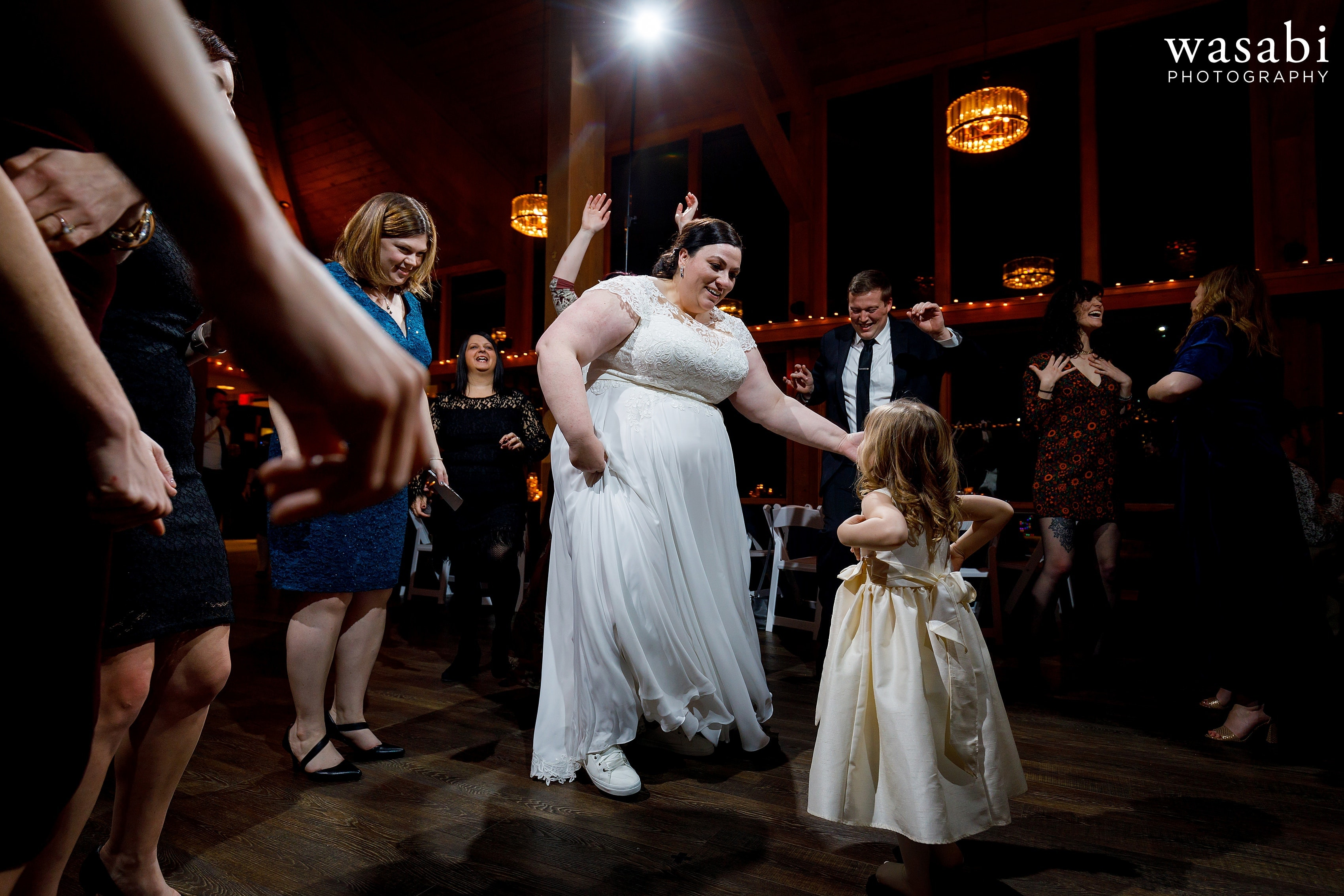 bride dances with flower girl and friends during wedding reception at Oak Brook Bath and Tennis Club
