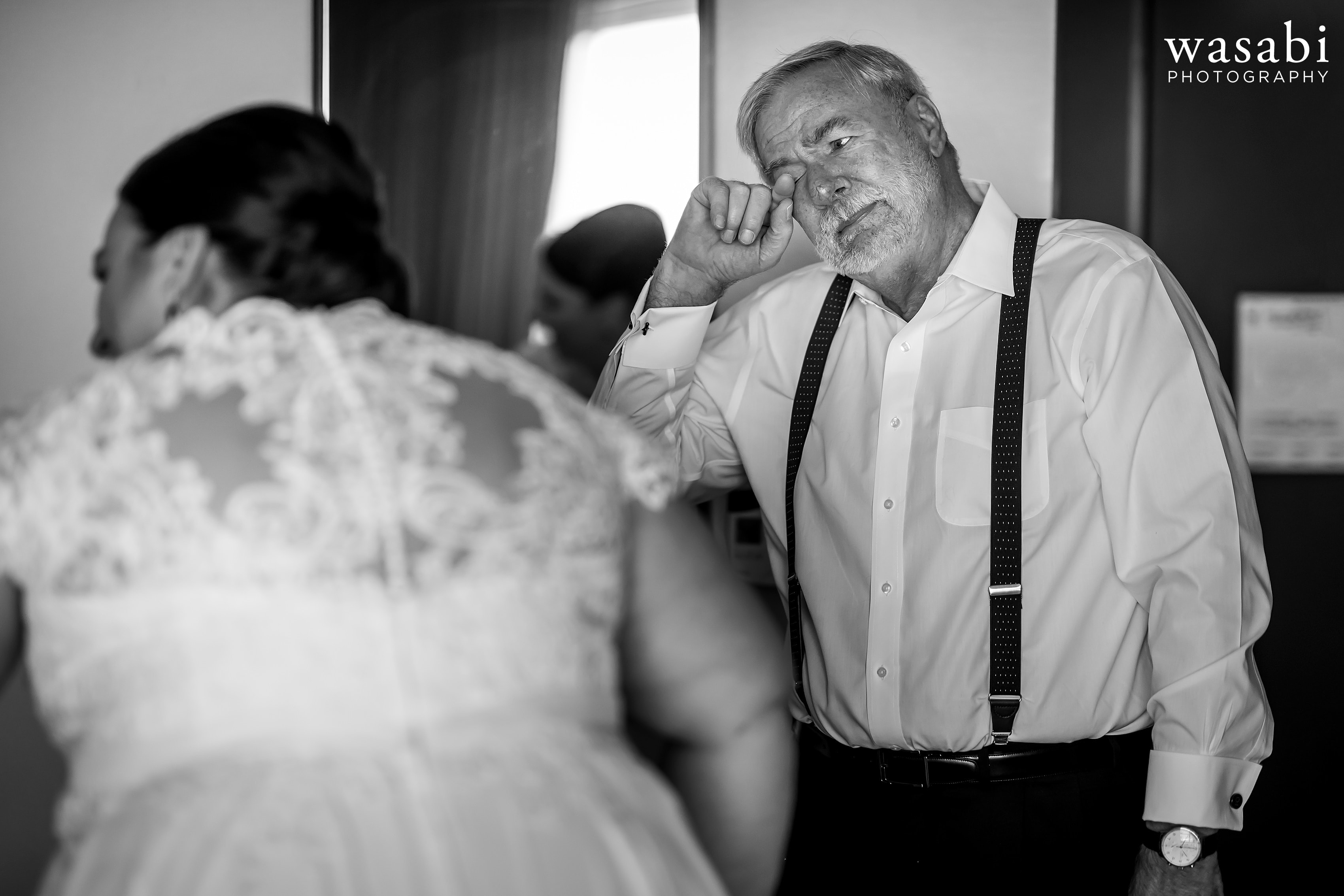 father of bride reacts to seeing bride in her wedding dress for the first time