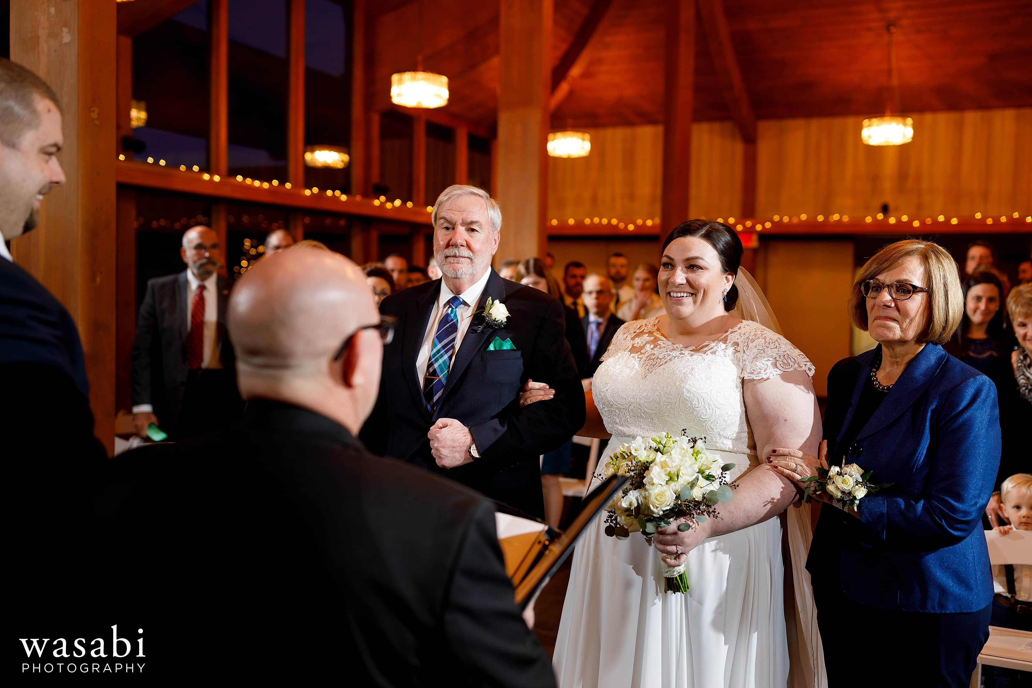 groom bride meet at the alter with her parents during wedding ceremony at Oak Brook Bath and Tennis Club
