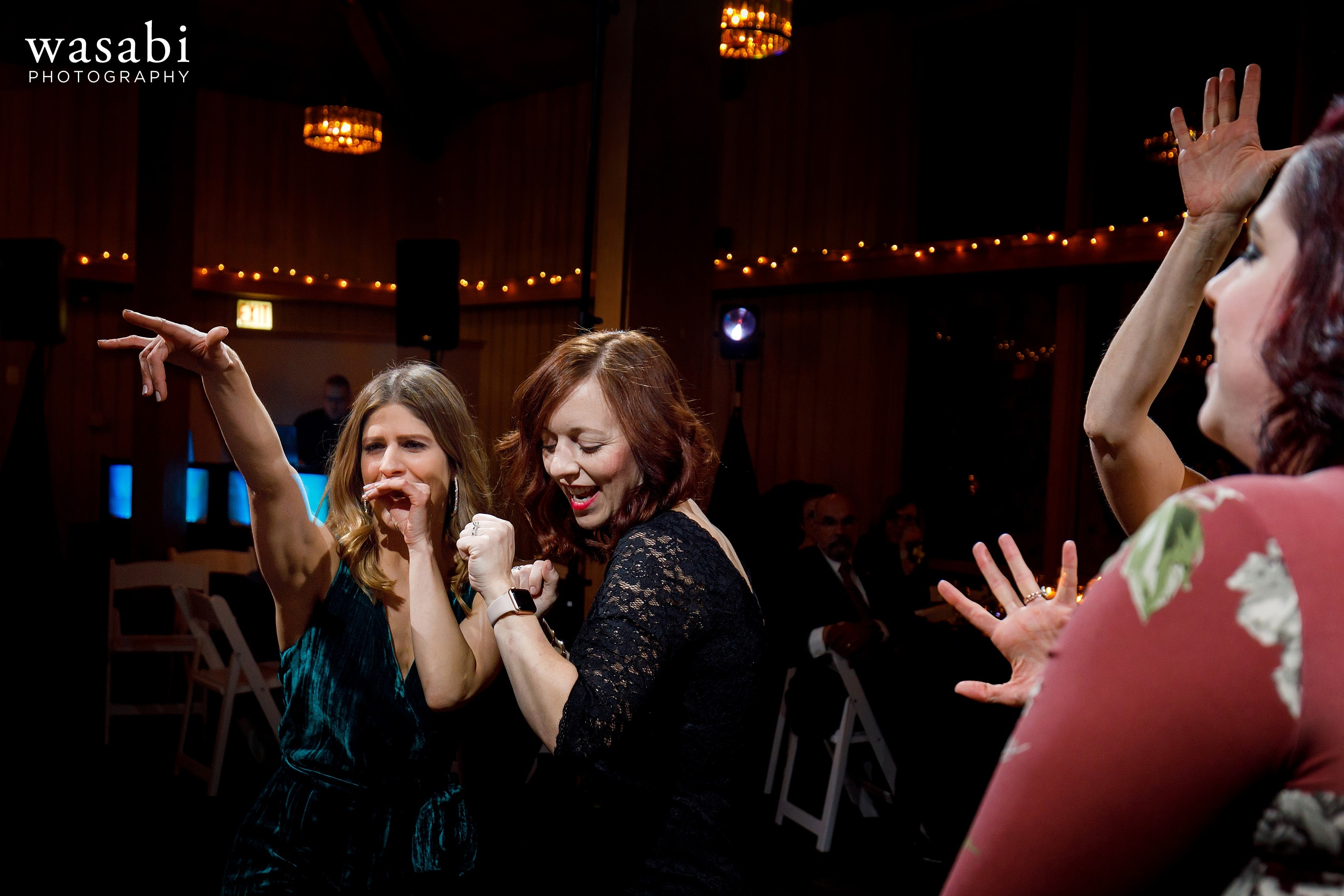 guests dance during wedding reception at Oak Brook Bath and Tennis Club