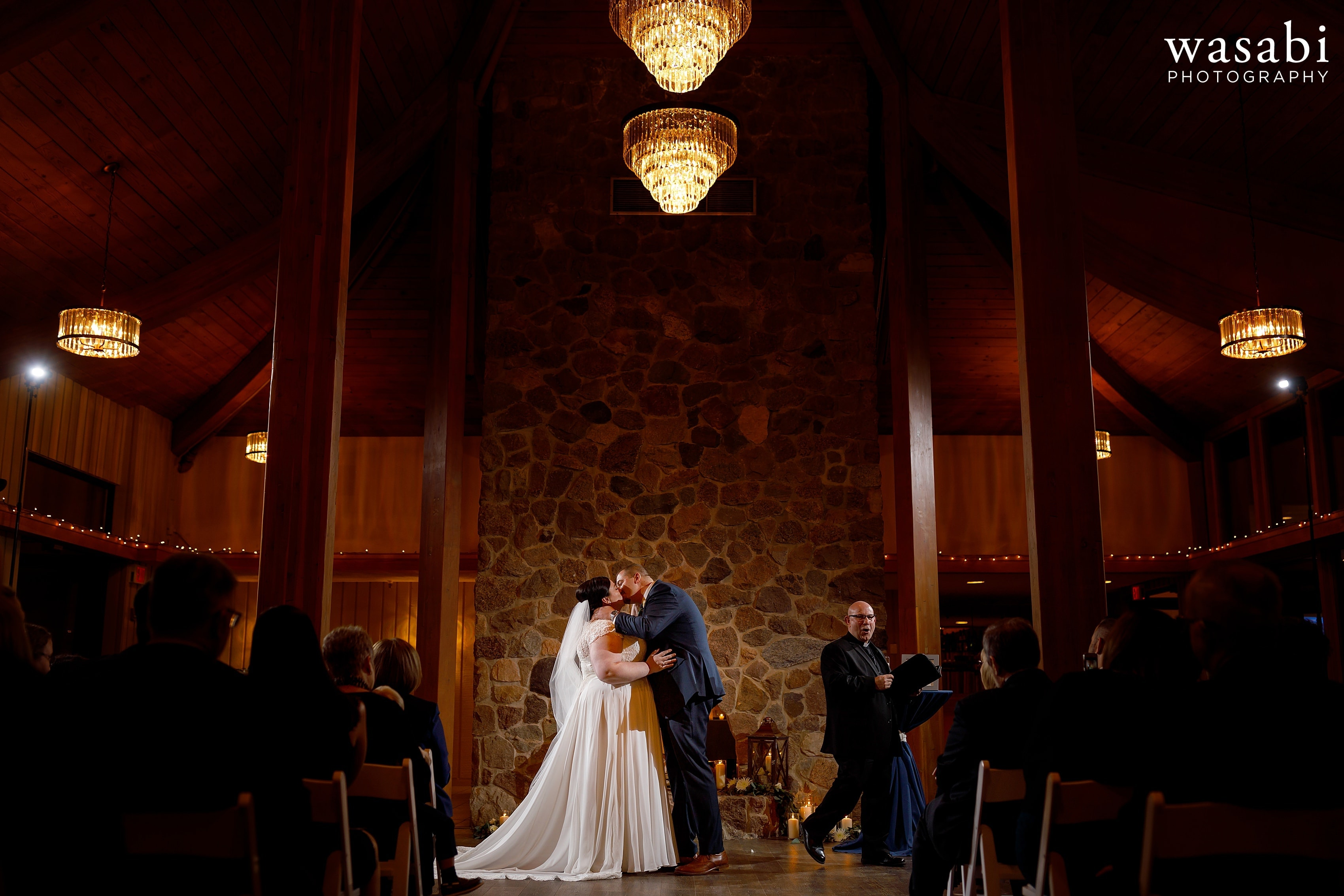 wide angle photo showing venue with bride and groom's first kiss during wedding ceremony at Oak Brook Bath and Tennis Club