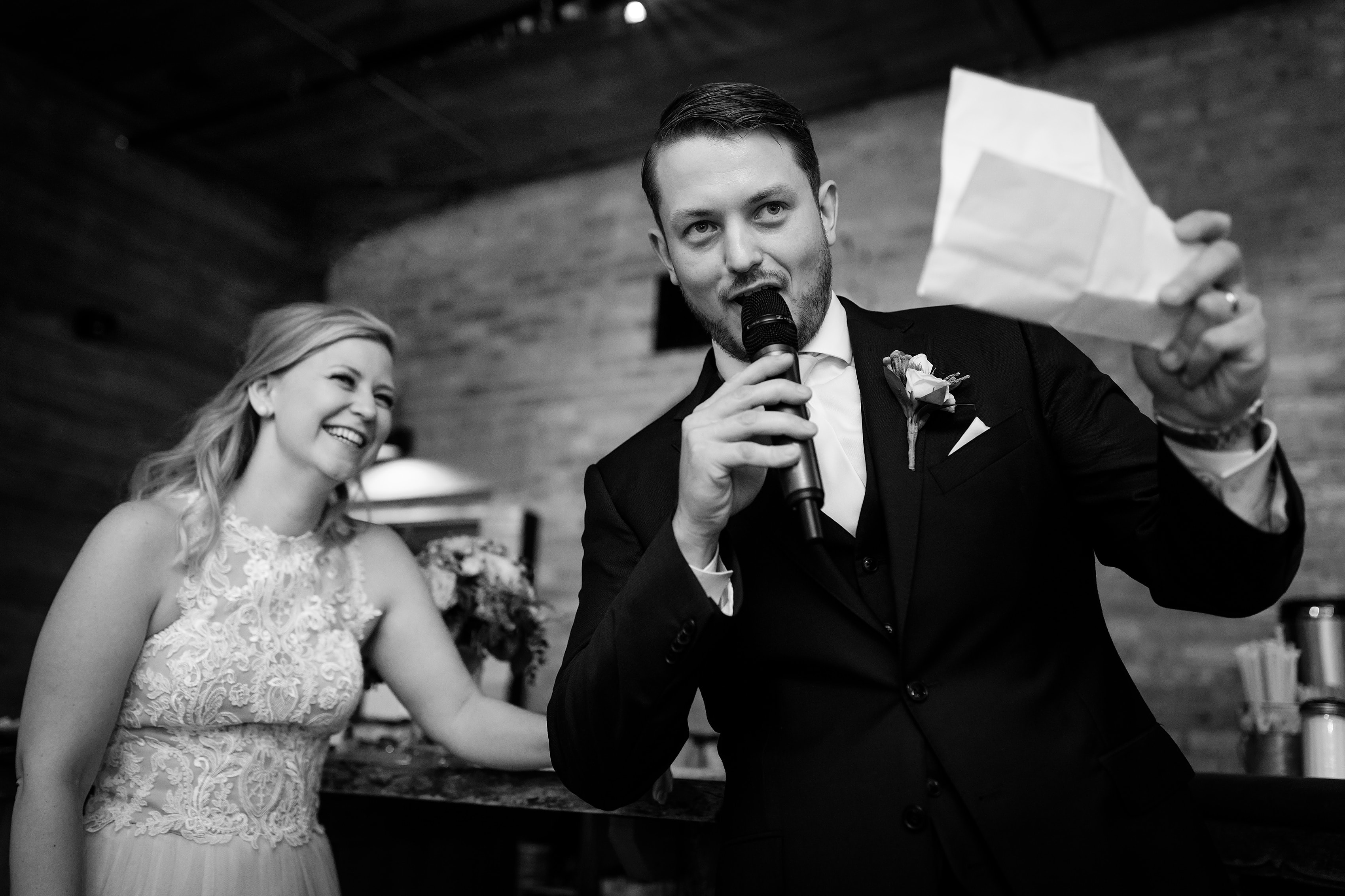 wedding Couple during reception at Anodyne coffee roasting co. in Milwaukee Wisconsin