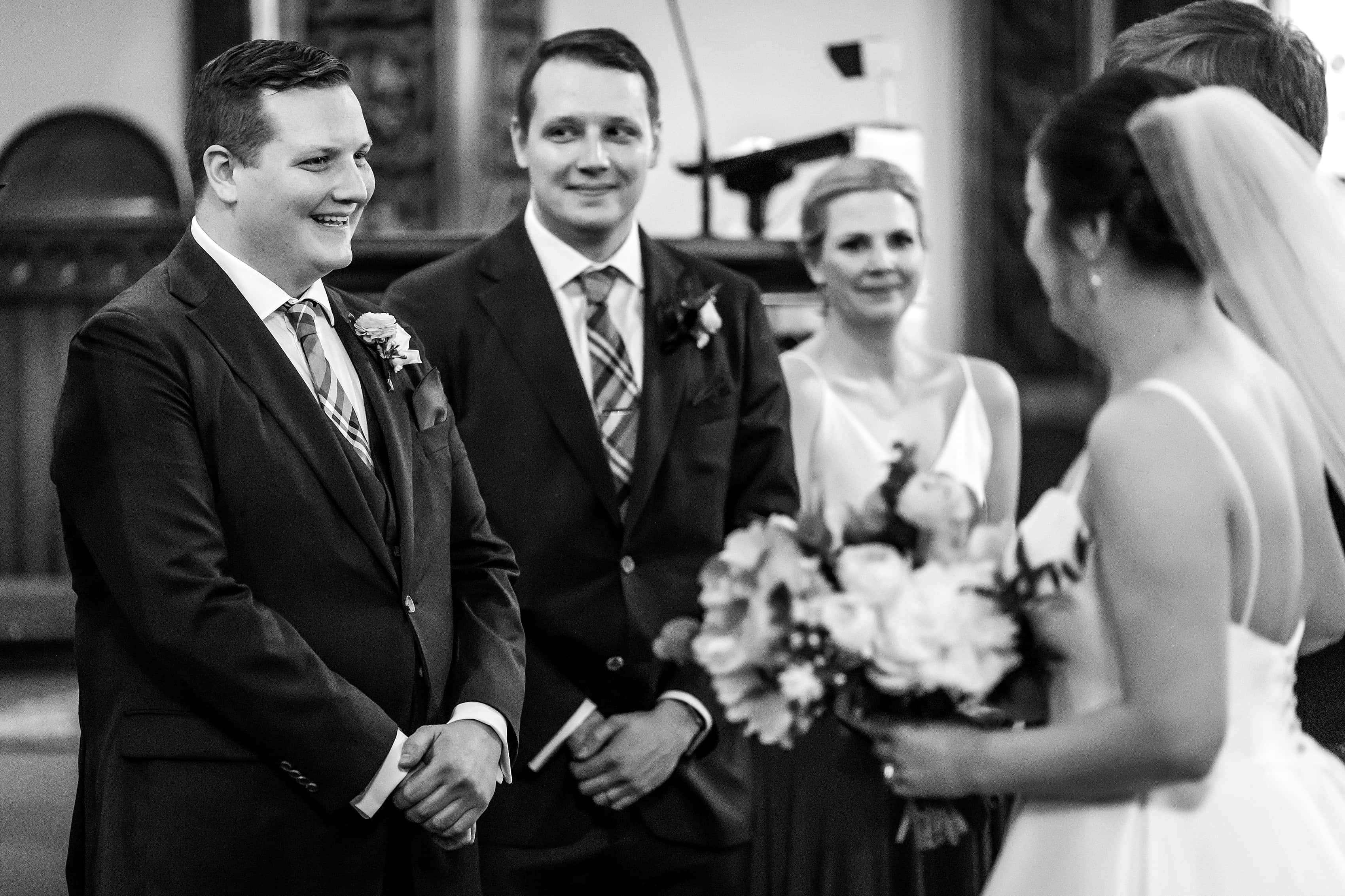 groom reacts to seeing bride during wedding ceremony at Church of our Savior