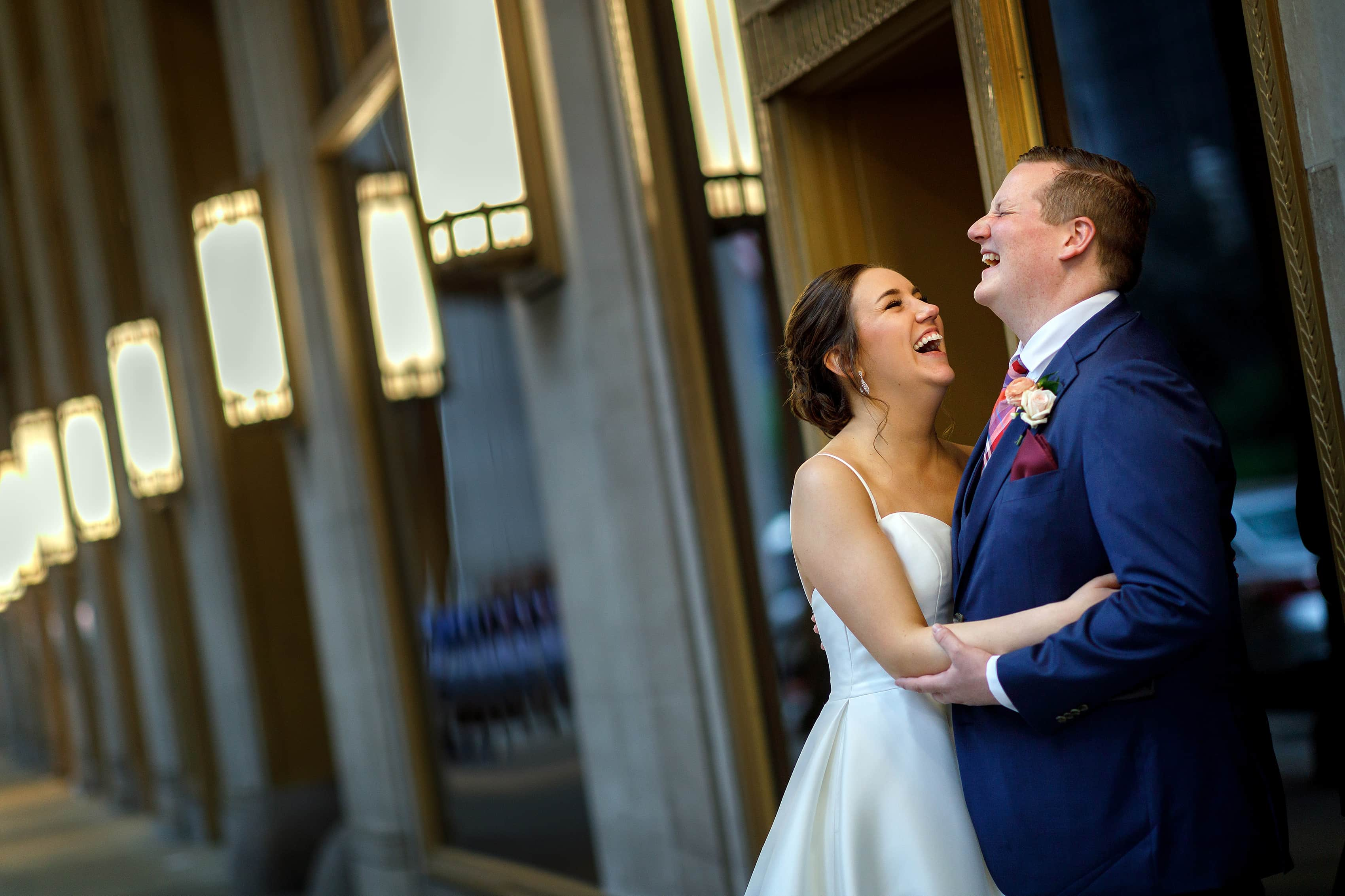bride and groom laugh during wedding portrait at Lyric Opera House in Chicago
