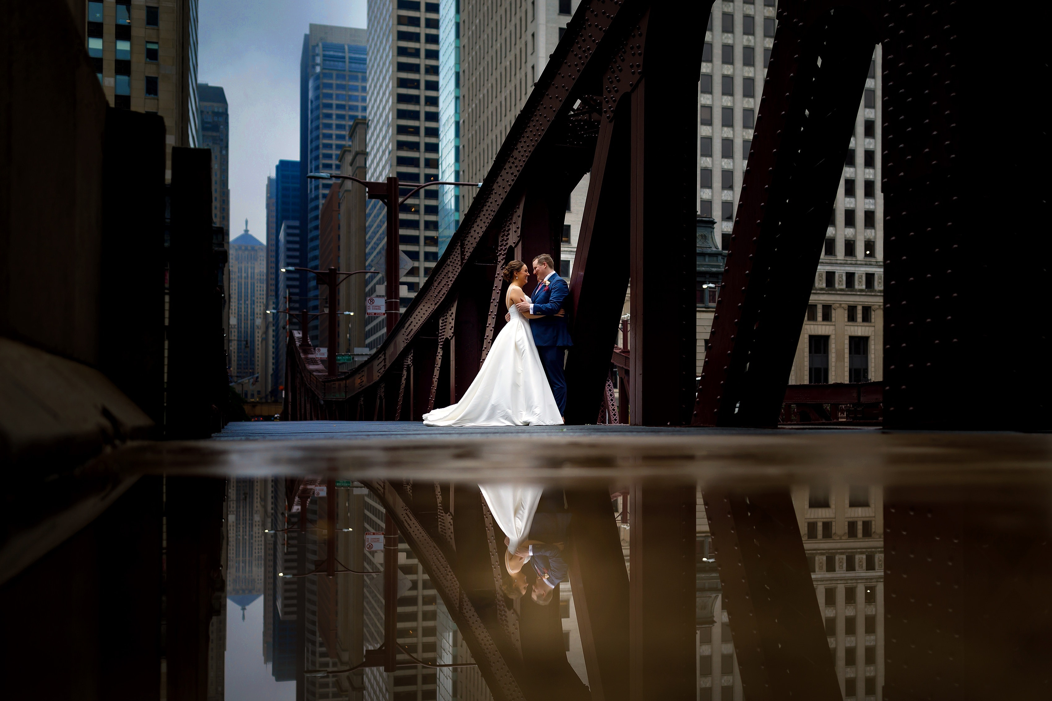 Bride and groom pose for portrait on LaSalle Street Bridge