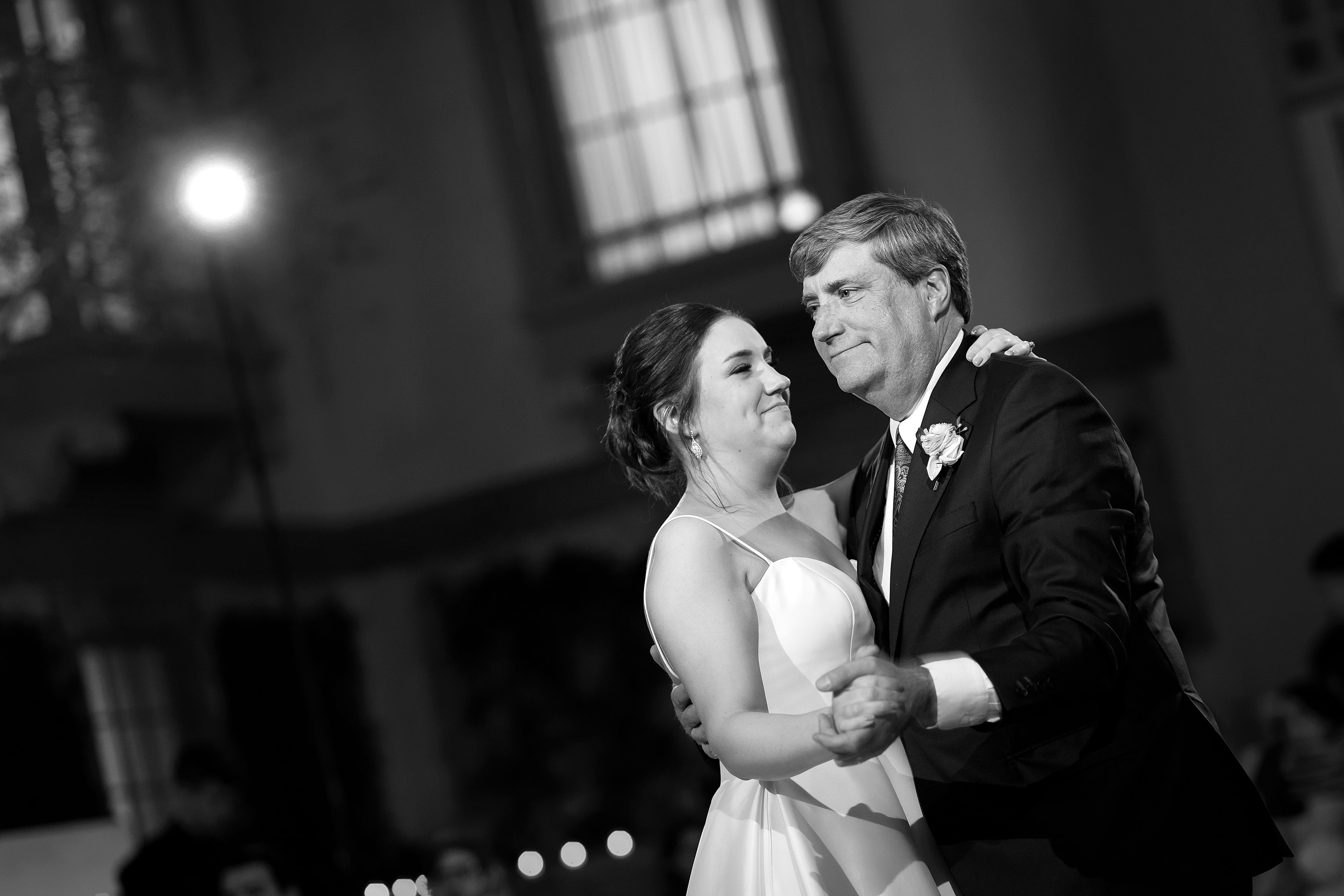 Bride and father first dance during wedding reception at Harold Washington Library