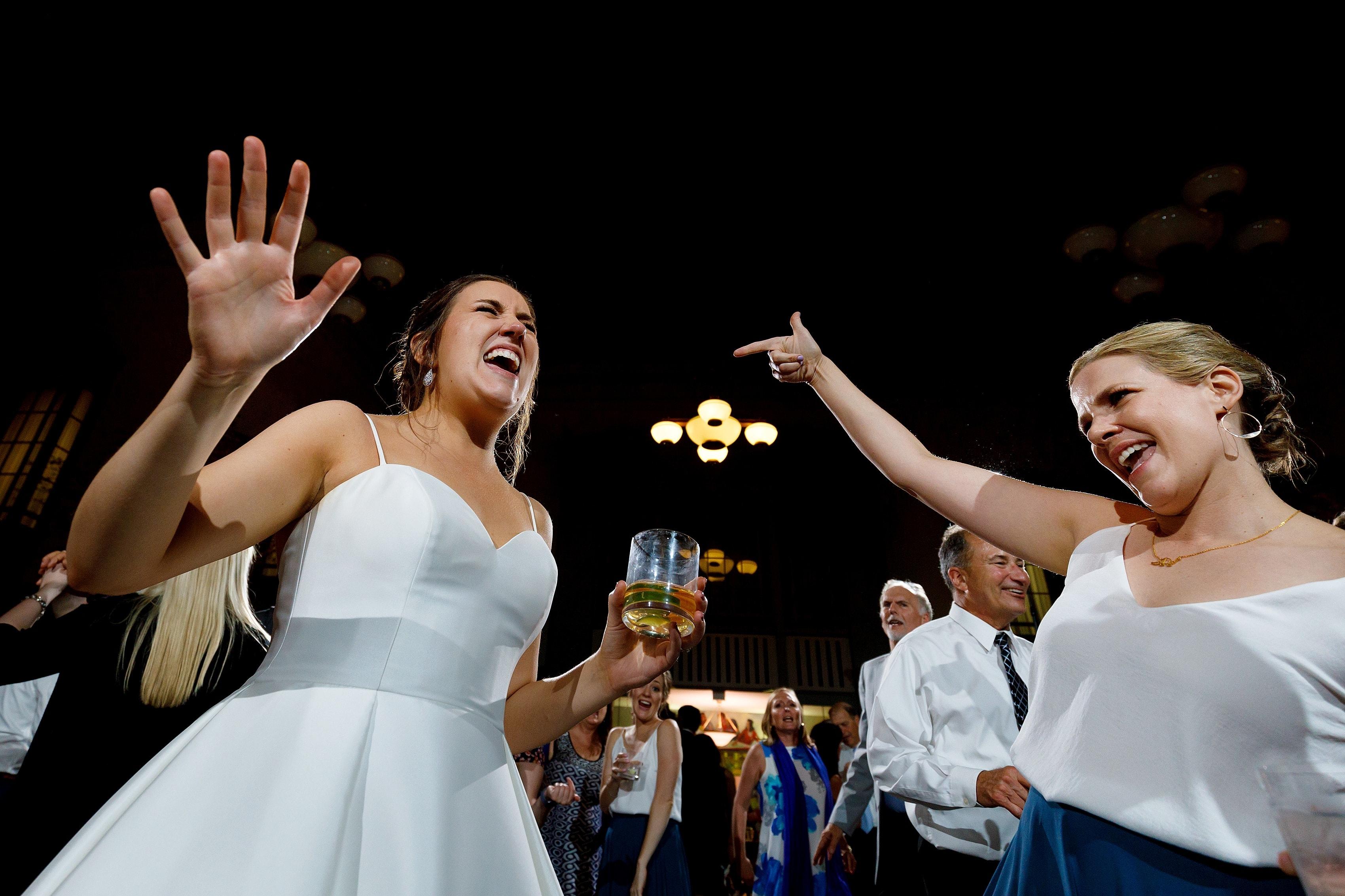 bride and wedding guests dancing during wedding reception at Harold Washington Library