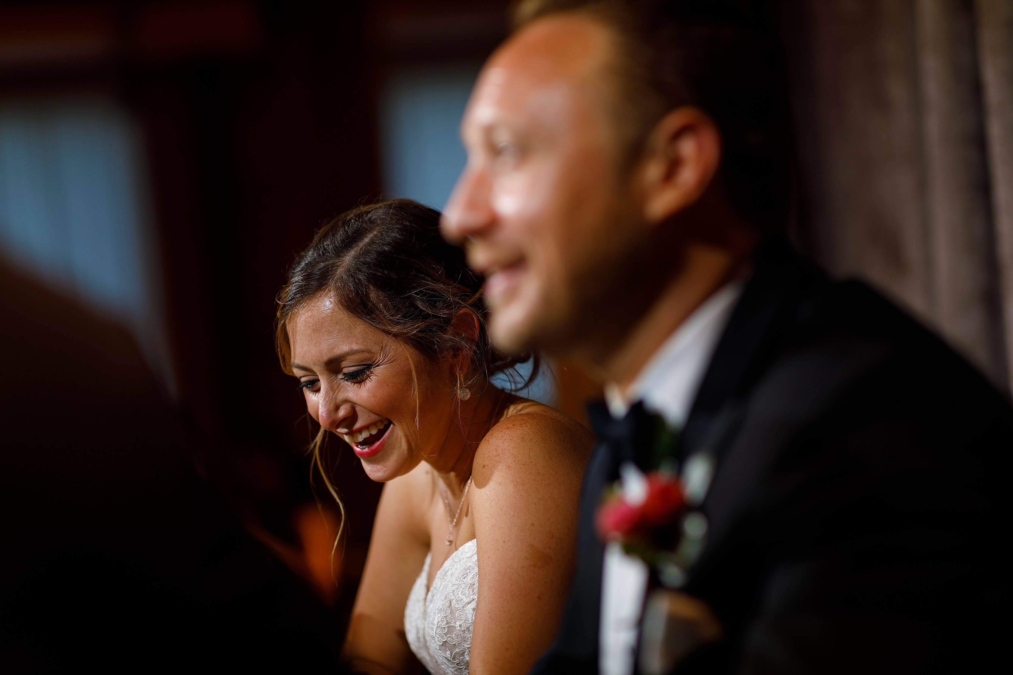 bride and groom laugh during toasts at wedding reception at Bridgeport Art Center Sculpture Garden in Chicago
