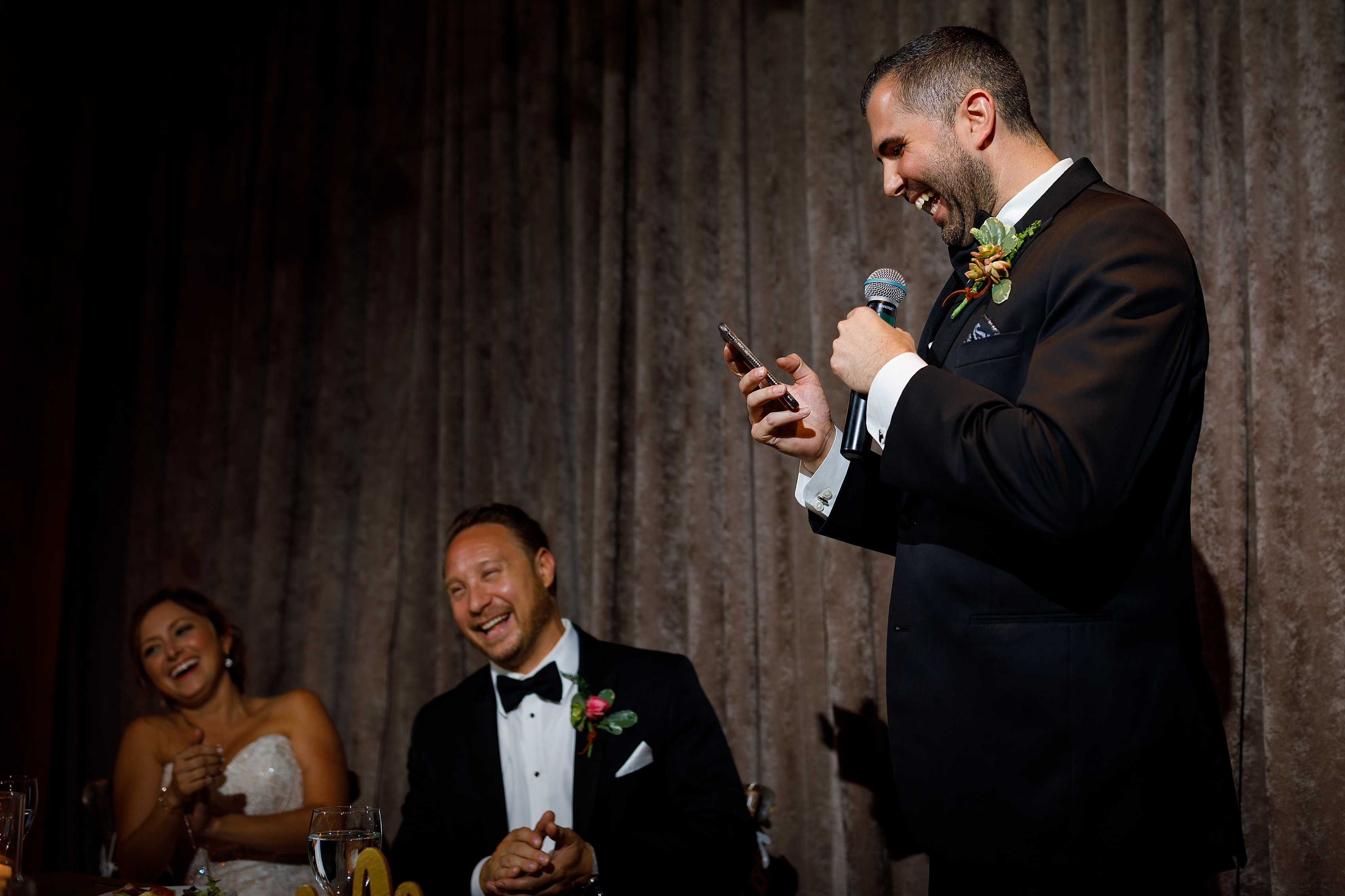 groomsman gives toast during wedding reception at Bridgeport Art Center Sculpture Garden in Chicago