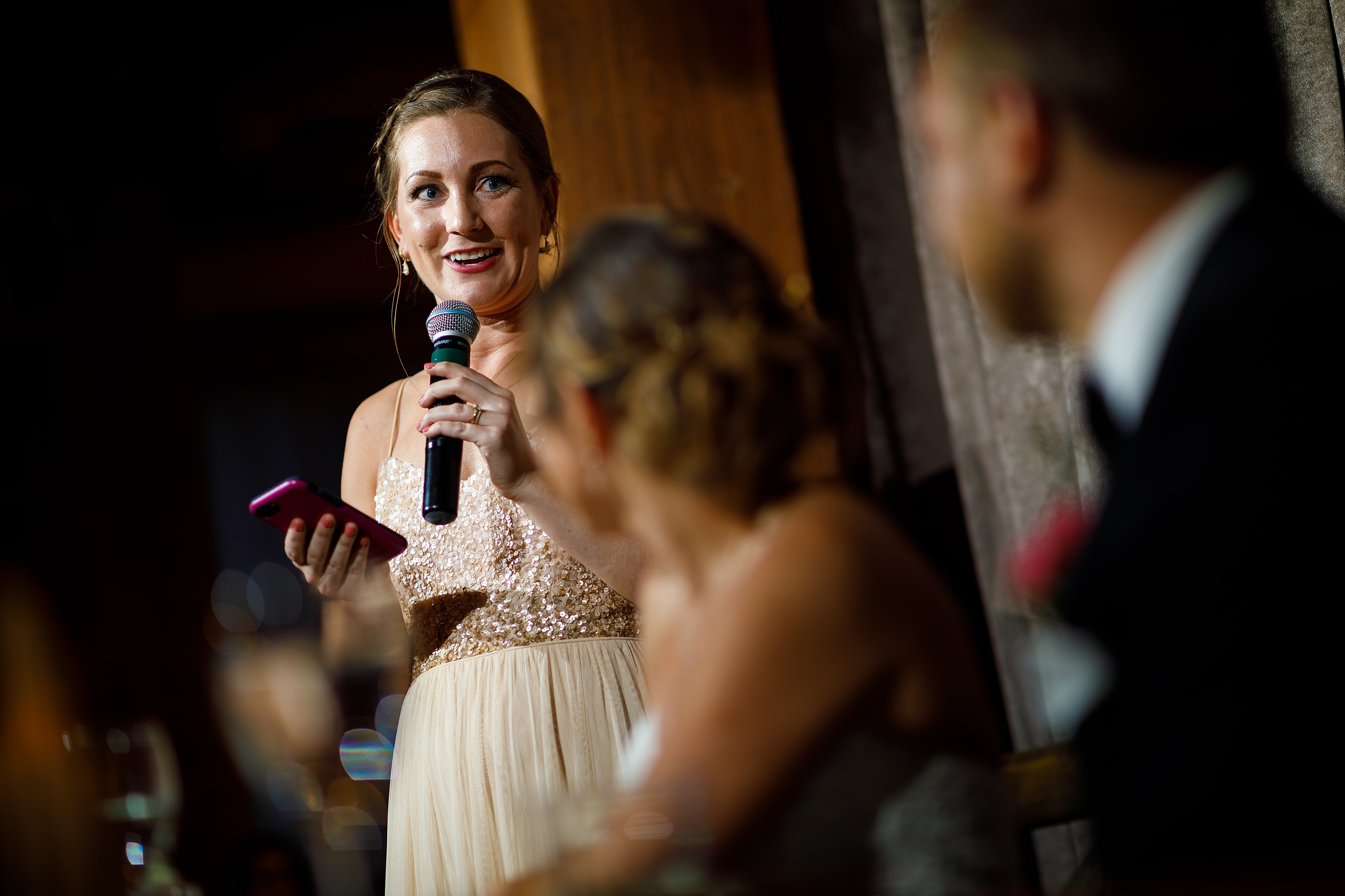 bridesmaid gives toast during wedding reception at Bridgeport Art Center Sculpture Garden in Chicago