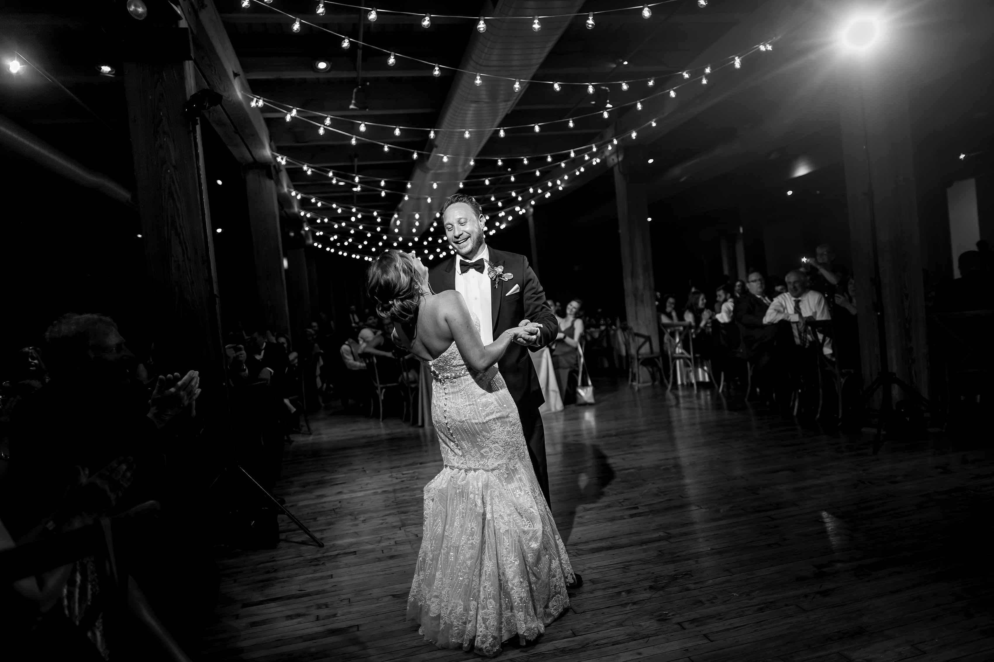 bride and groom share their first dance during wedding reception at Bridgeport Art Center Sculpture Garden in Chicago