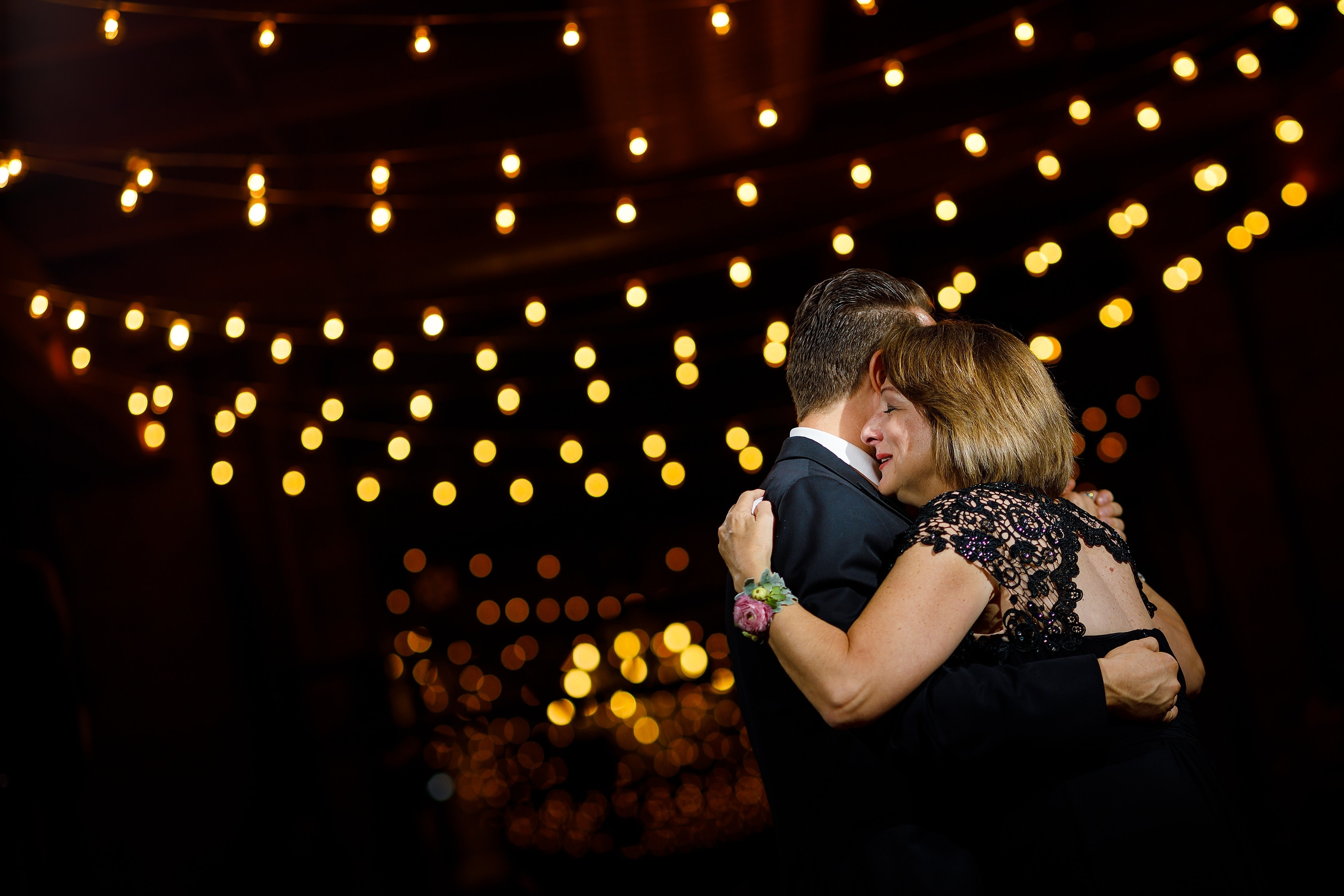 groom shares dance with mother during wedding reception at Bridgeport Art Center Sculpture Garden in Chicago