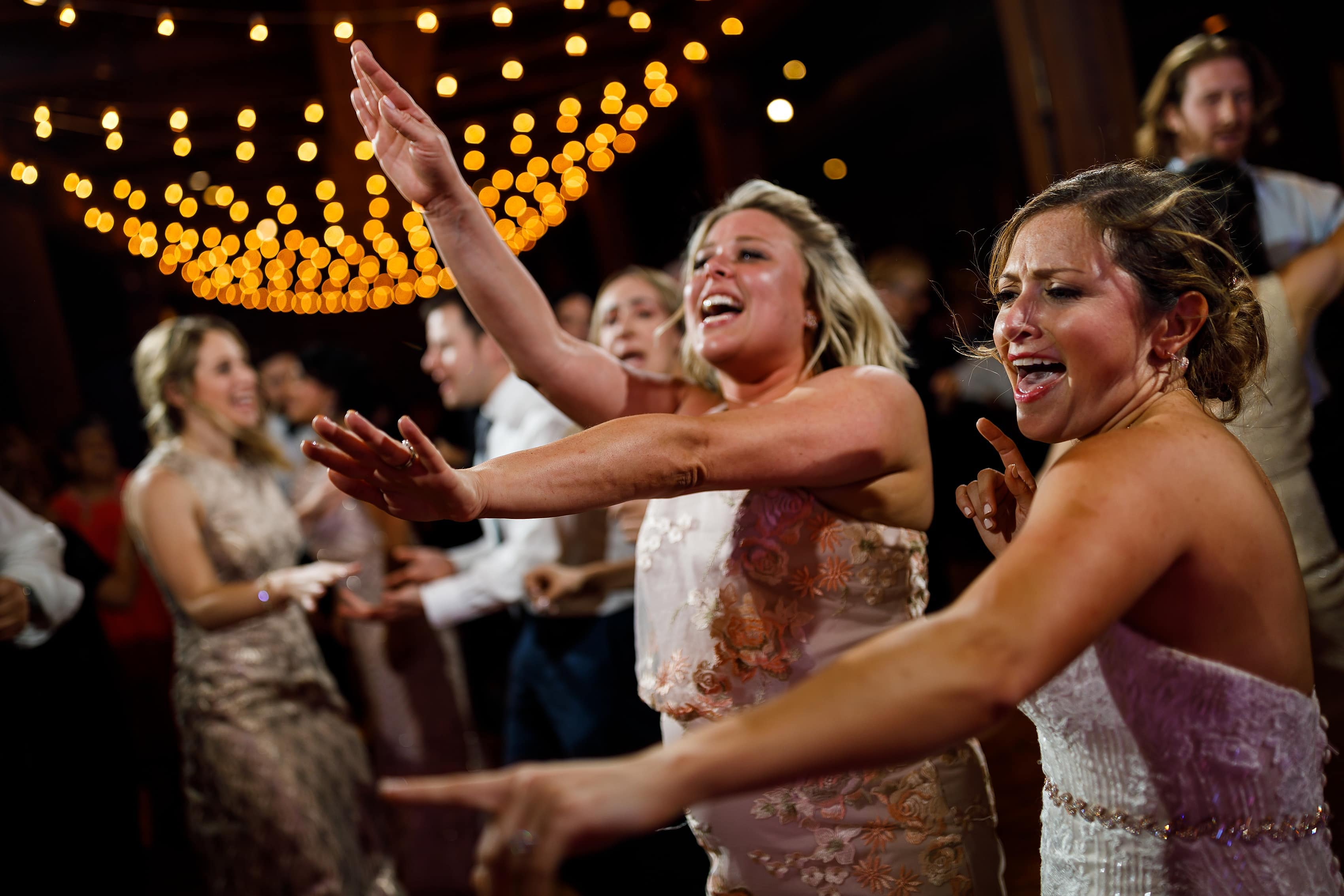 bride dances with sister during wedding reception at Bridgeport Art Center Sculpture Garden in Chicago