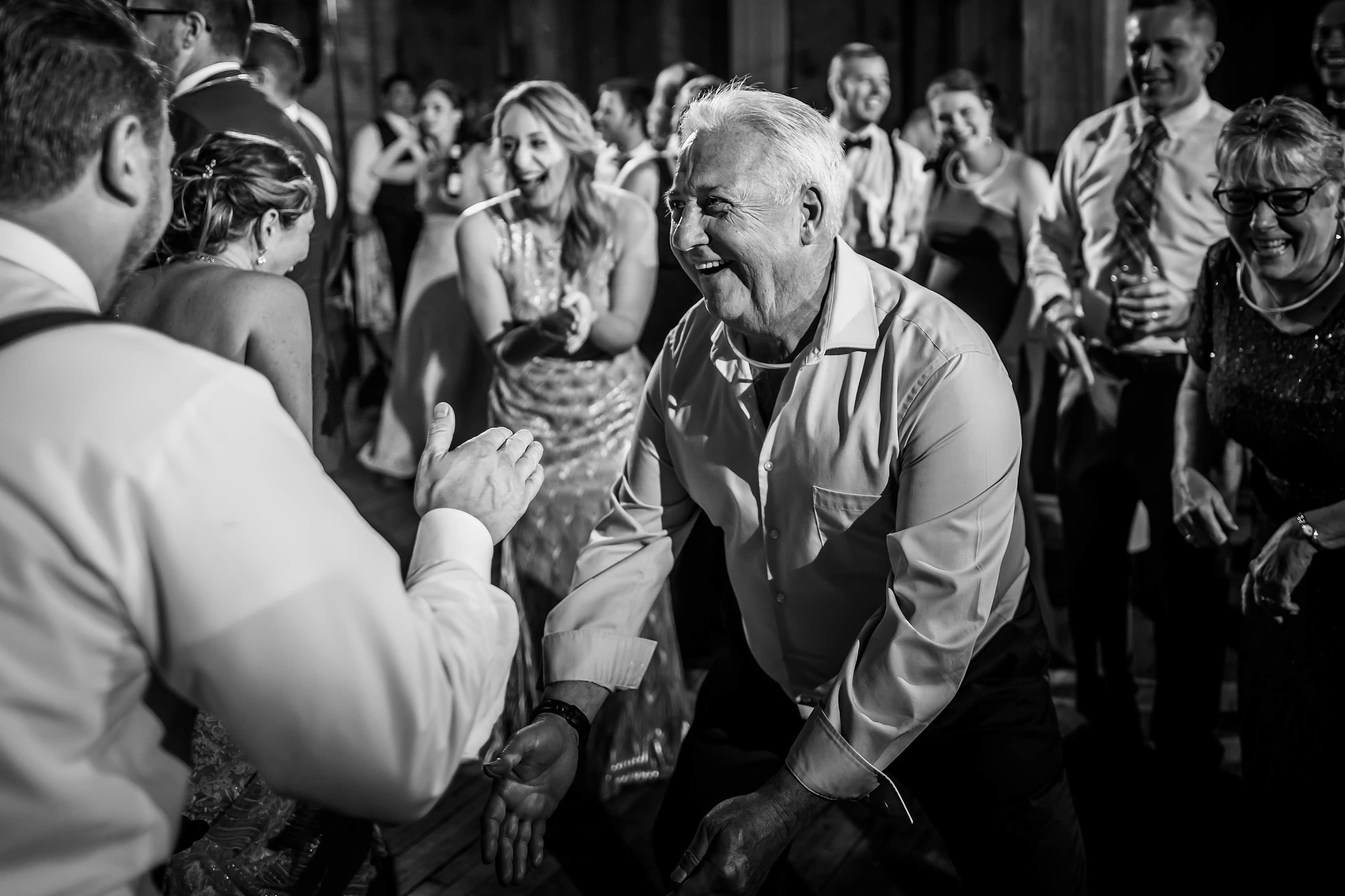 wedding guests dance during wedding reception at Bridgeport Art Center Sculpture Garden in Chicago