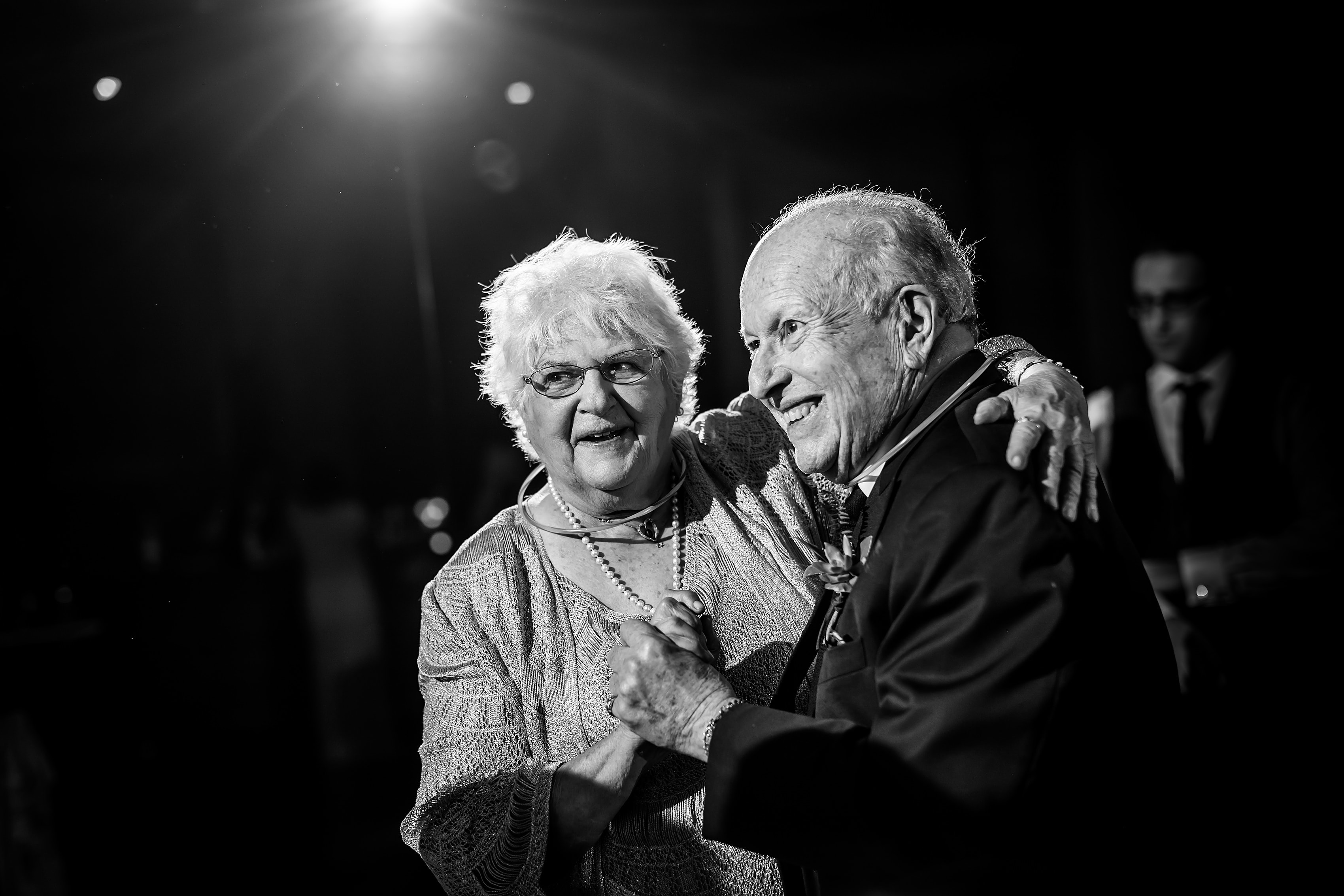 grandparents dance during wedding reception at Bridgeport Art Center Sculpture Garden in Chicago