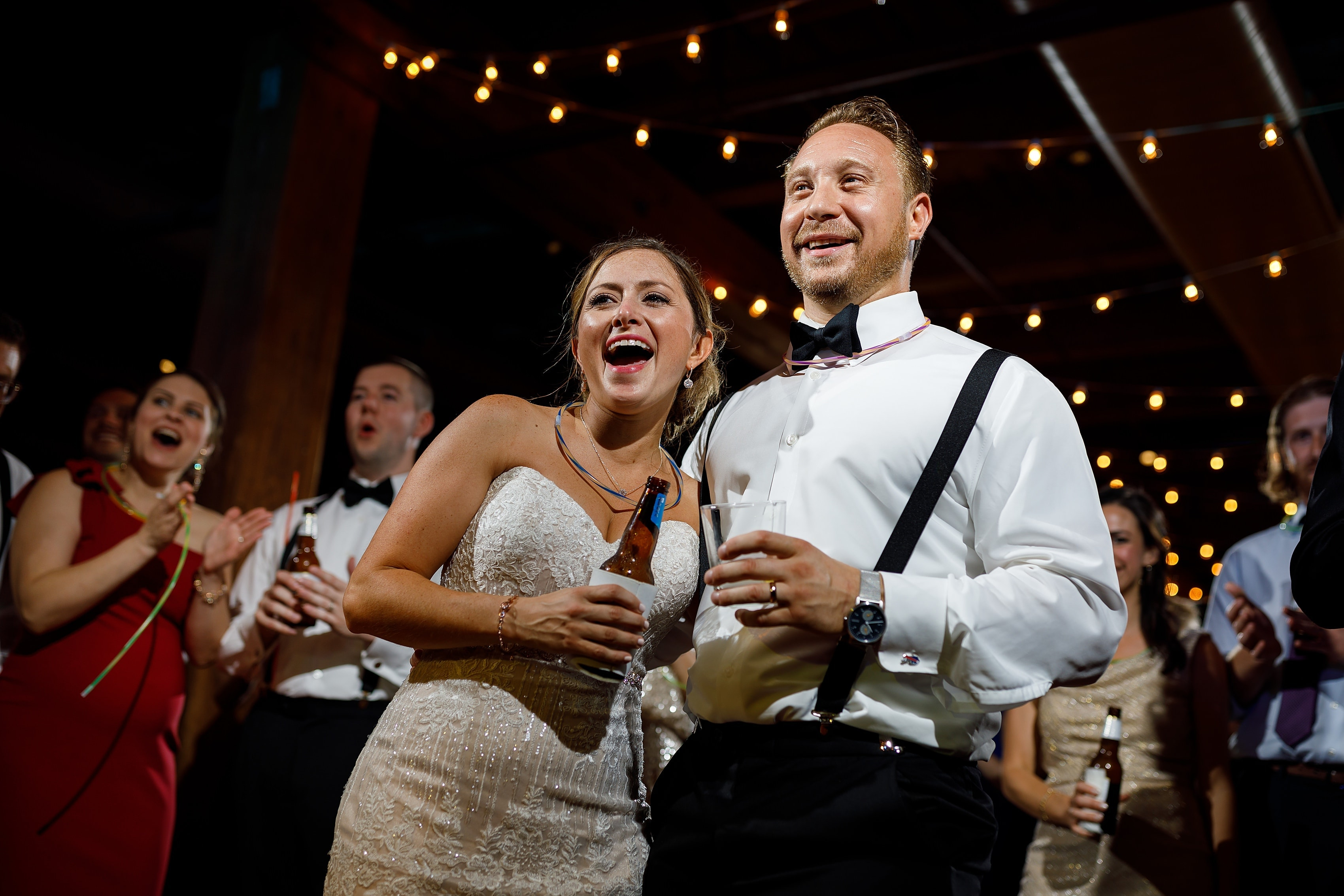 bride and groom react to special piano performance by groomsman during wedding reception at Bridgeport Art Center Sculpture Garden in Chicago