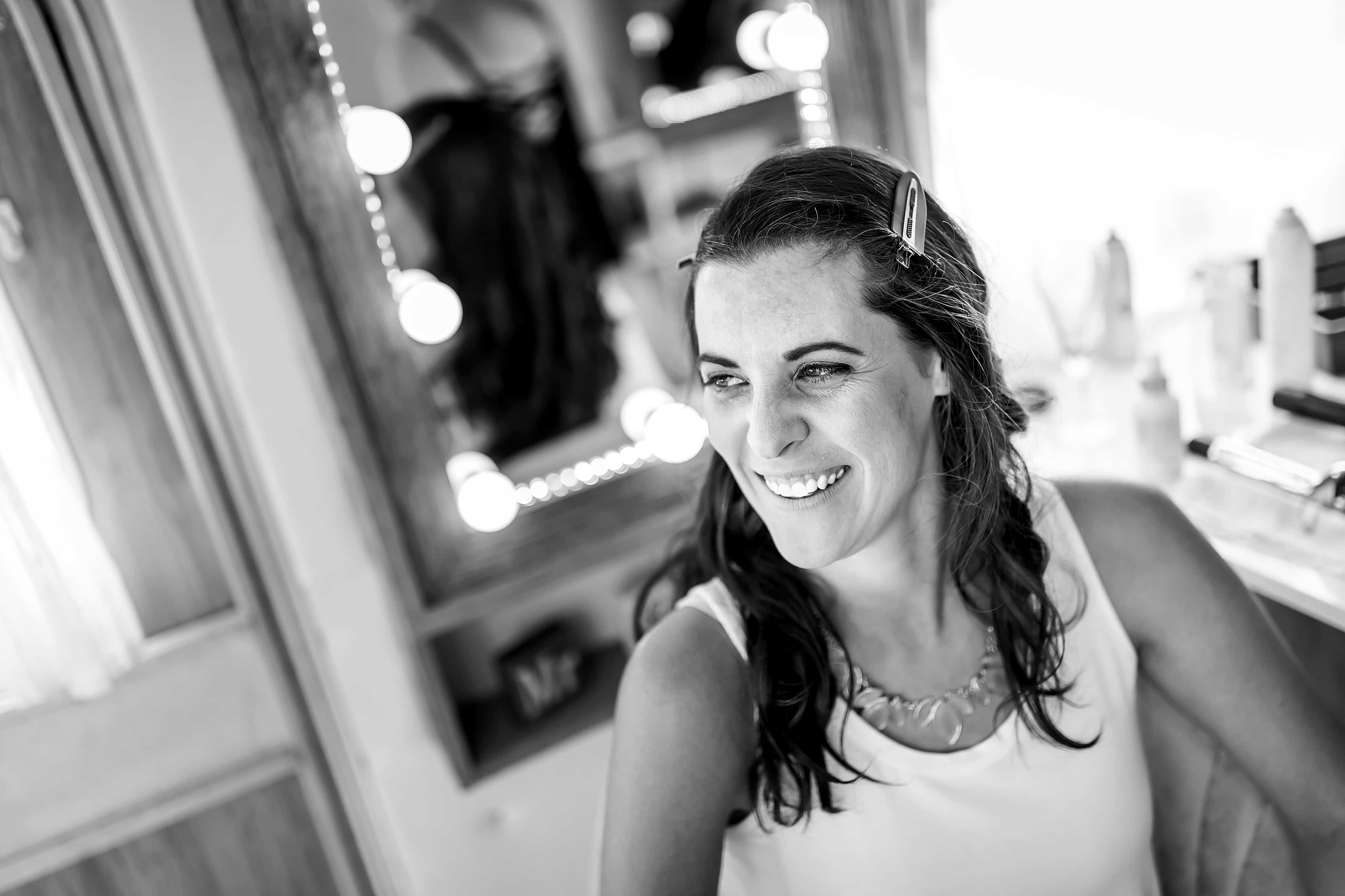 bride gets ready for wedding in makeup trailer at Lionsgate Event Center