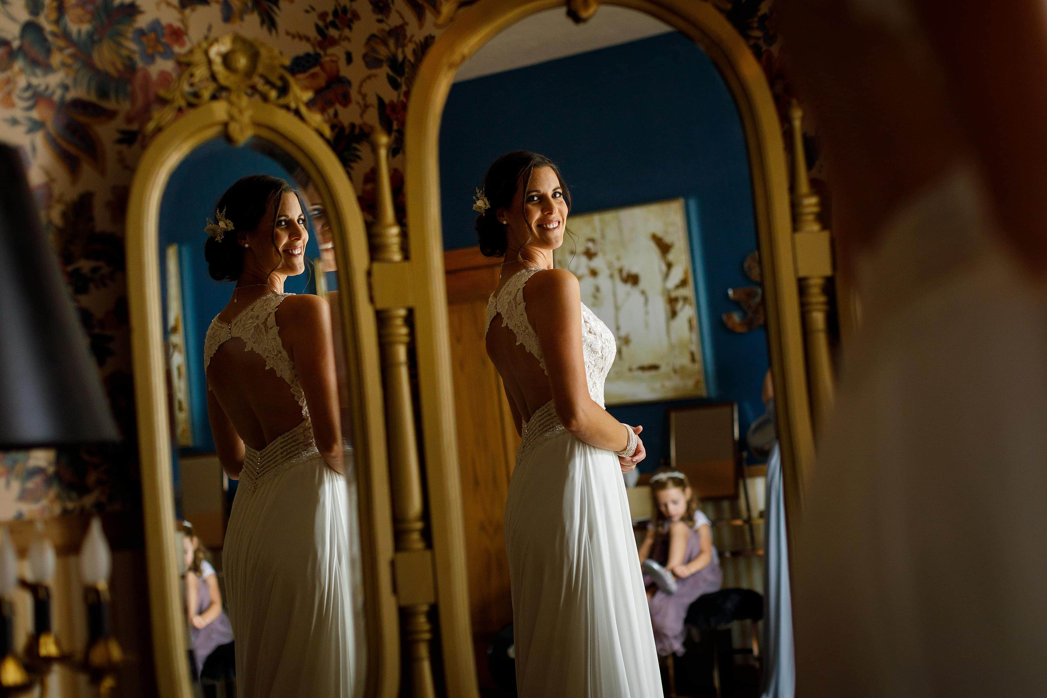 bride looks in mirror in bridal suite at Lionsgate Event Center